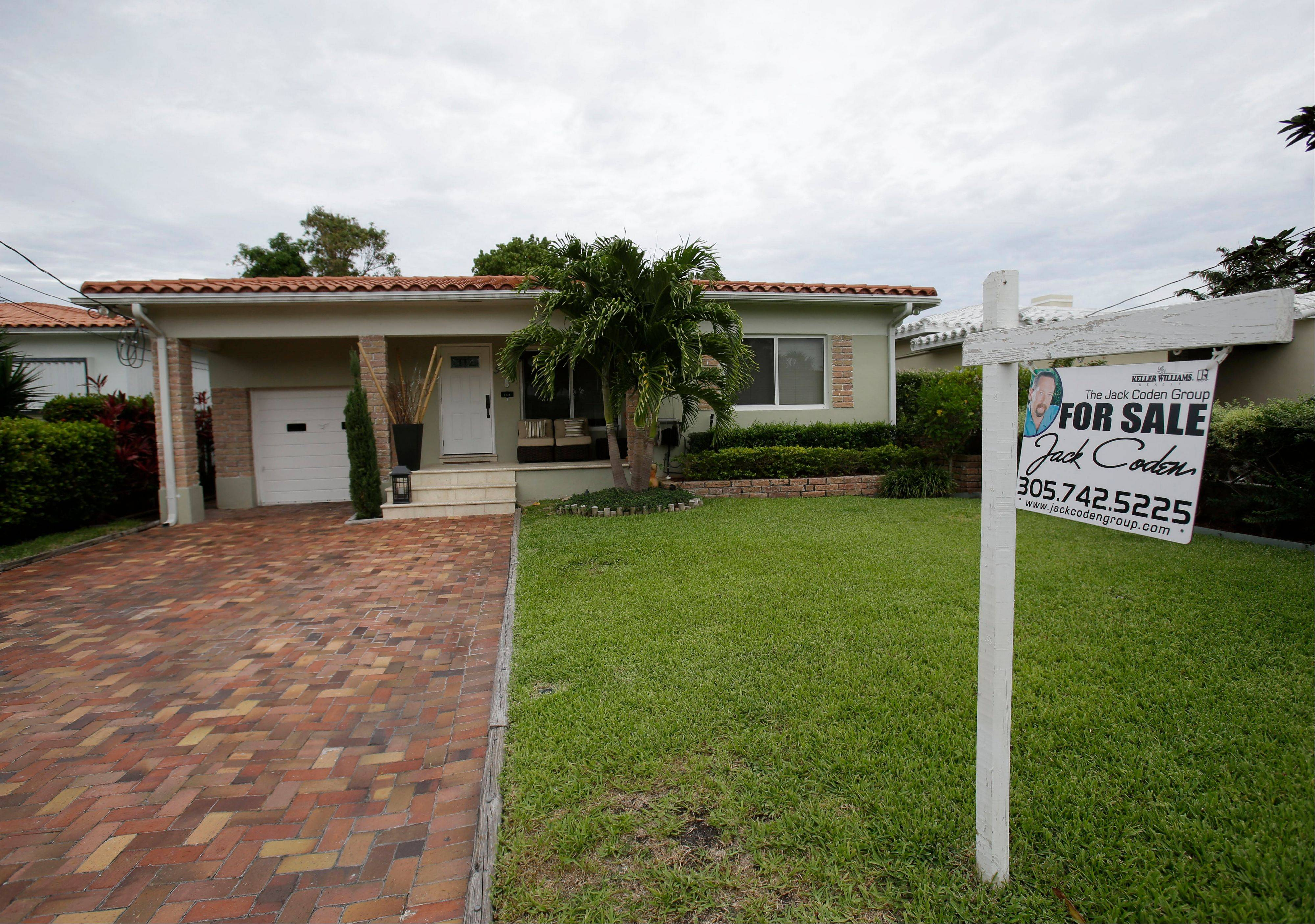 U.S. home prices jumped 12.2 percent in May from a year ago, the most in seven years. The increase suggests the housing recovery is strengthening.