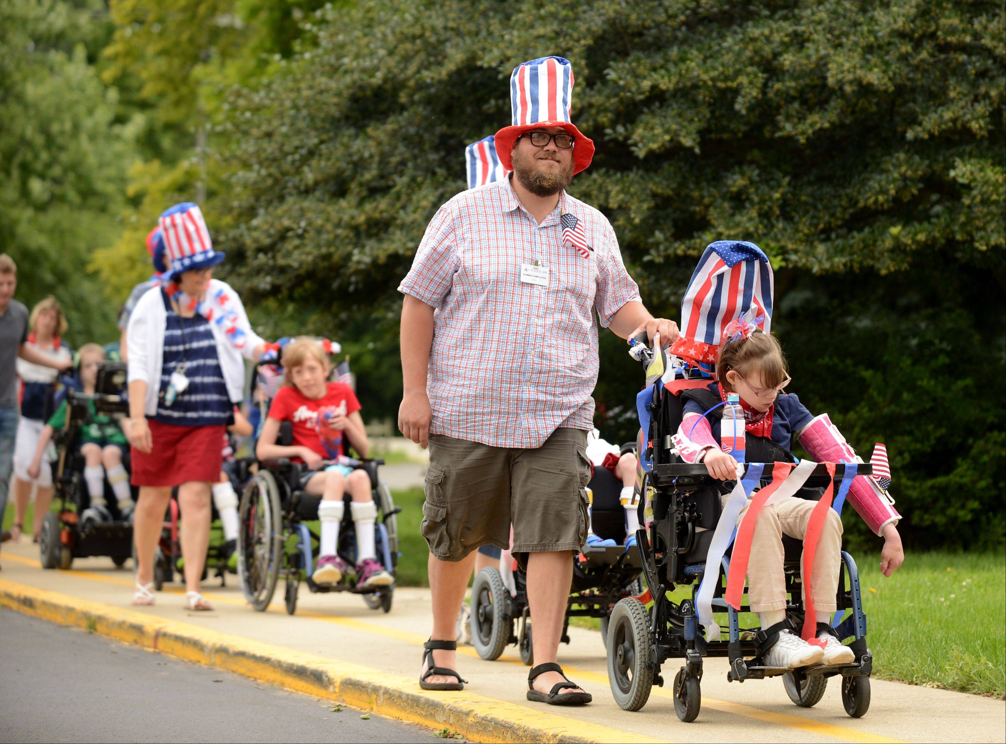 Scott Lutz and Anna Herpolsheimer were some of the more highly decorated participants in Tuesday's Independence Day Parade at Warrenville's Elementary School.