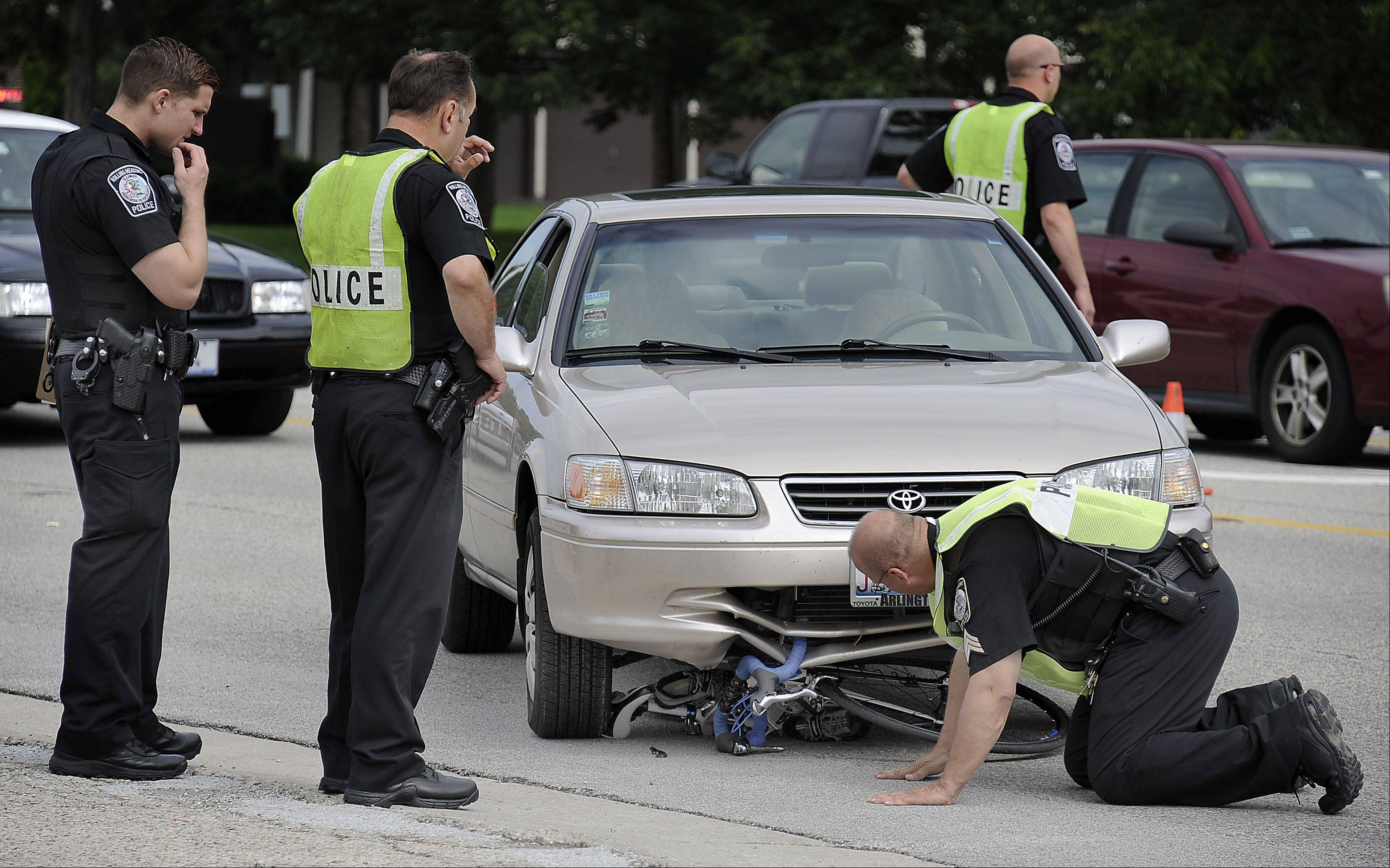 Rolling Meadows police investigate a bike accident on Algonquin Road a few hundred feet west of Wilke Road Tuesday morning that sent a female bike rider to Northwest Community Hospital.