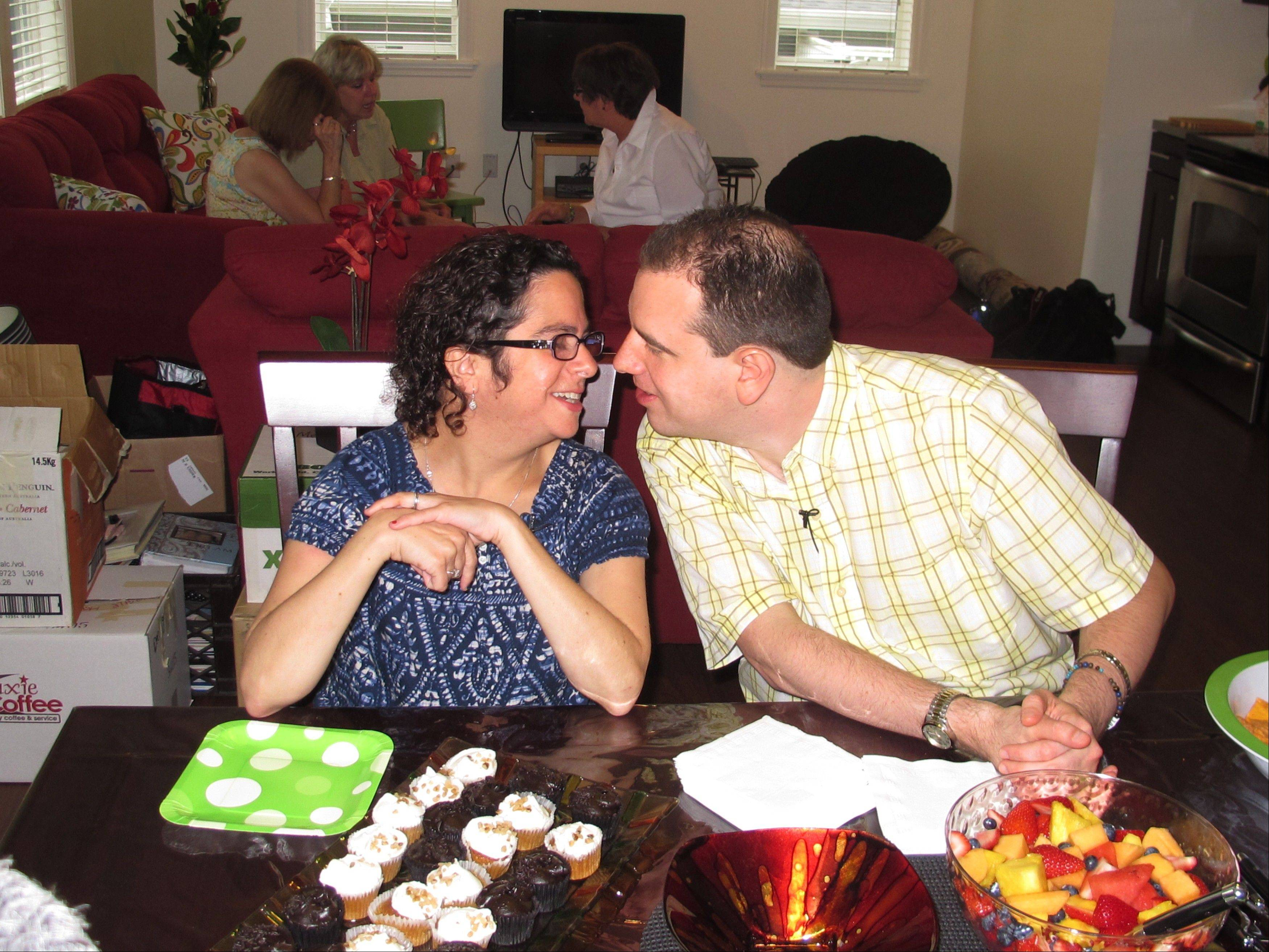 In this photo taken Monday, July 1, 2013, newlyweds Paul and Hava Forziano celebrate their first day in their new apartment at a group home in Riverhead, N.Y. The mentally disabled couple started a court fight after the group homes where they formerly lived denied them the opportunity to live together as a married couple.