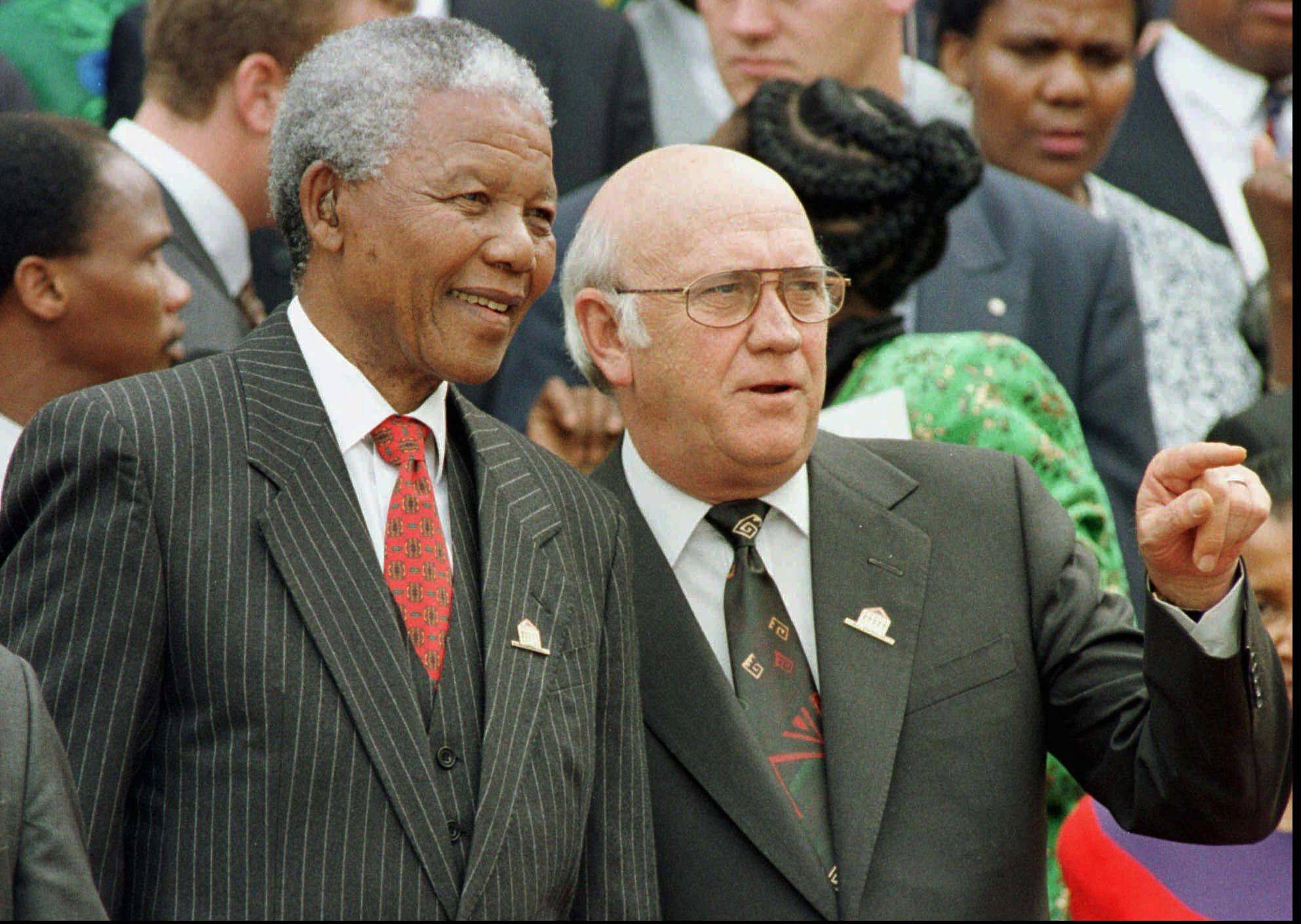 In this 1996 photo, South African President Nelson Mandela, left, and Deputy President F.W. de Klerk chat outside Parliament after the approval of South Africa�s new constitution. de Klerk, the last leader of the apartheid era and a co-recipient of the 1993 Nobel Peace Prize with Nelson Mandela, has suffered dizziness and will be fitted with a pacemaker, Tuesday June 2, 2013, to help his heart function.
