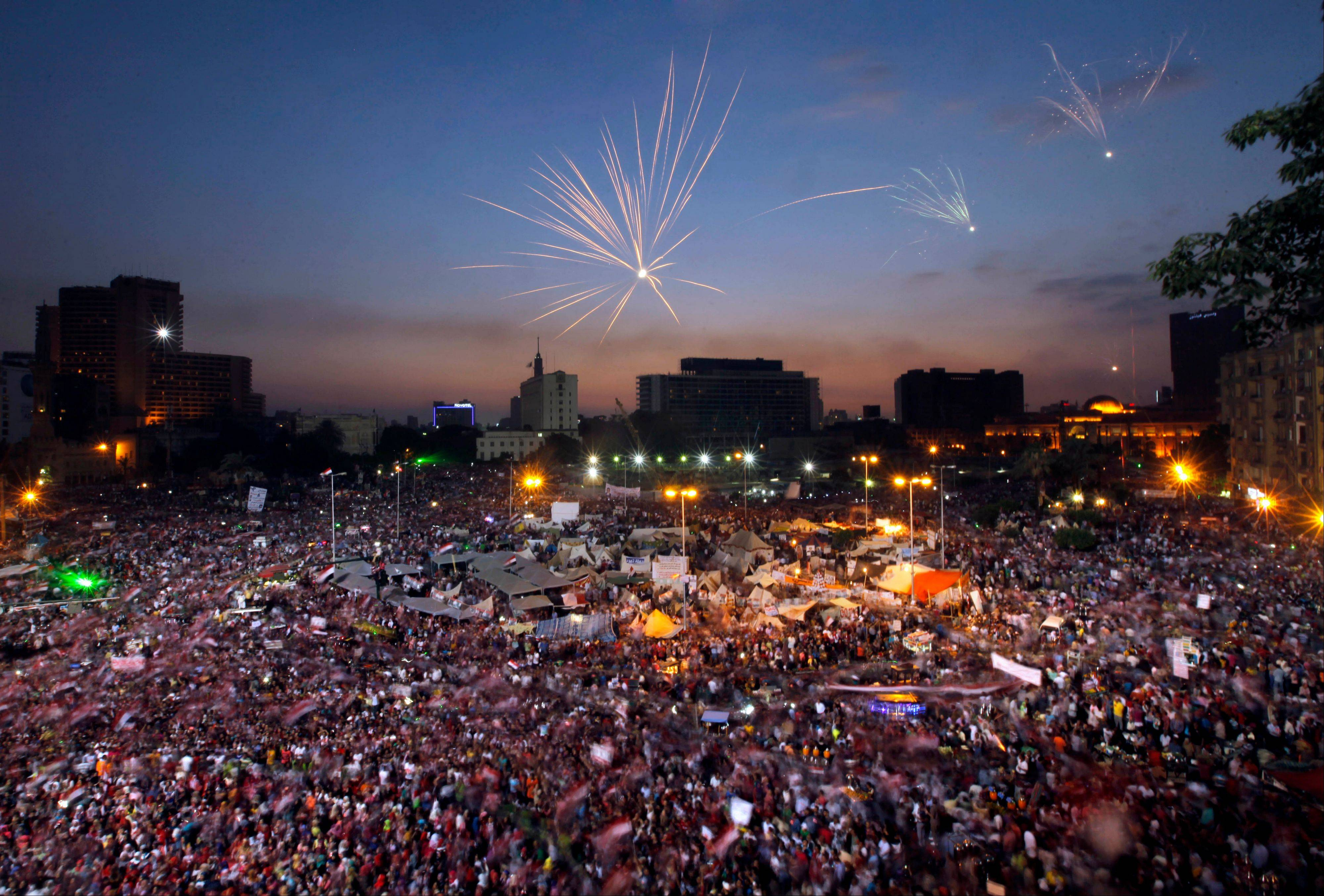 Fireworks burst over opponents of Egypt�s Islamist President Mohammed Morsi in Tahrir Square in Cairo, Egypt, Tuesday. With a military deadline for intervention ticking down, protesters seeking the ouster of Egypt�s Islamist president sought Tuesday to push the embattled leader further toward the edge with another massive display of people power.