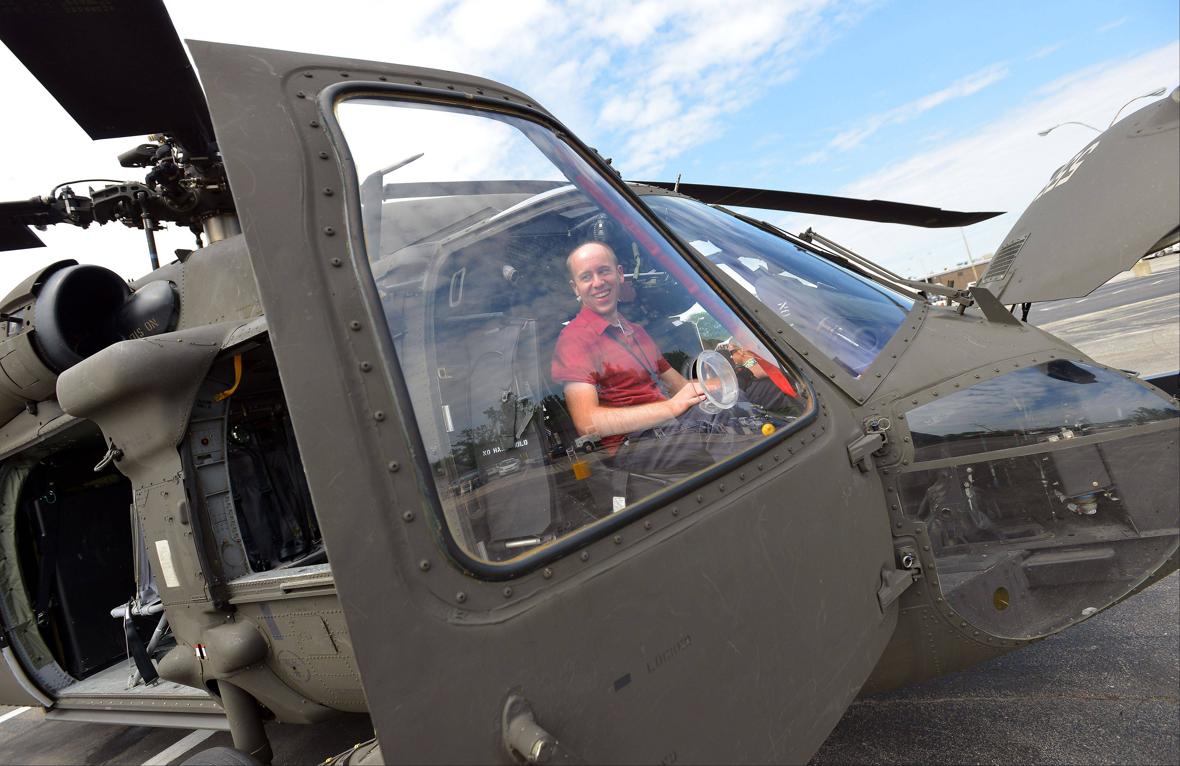 Northrop Grumman engineer Brian Dolder sits in the Black Hawk helicopter.