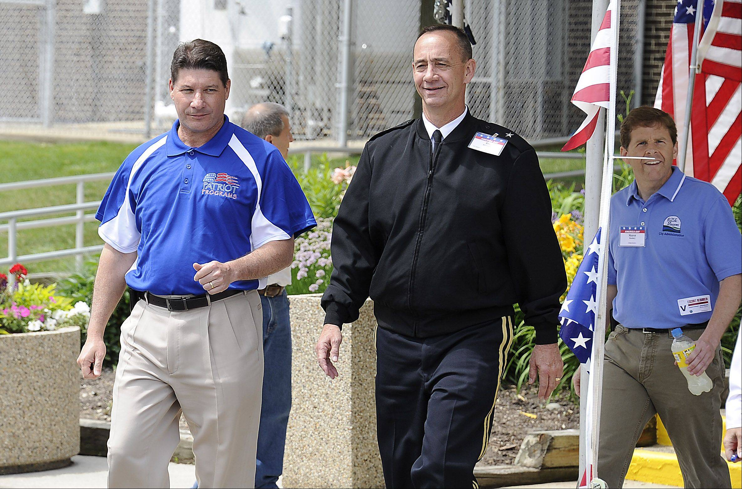 From left, Jeff Palombo, Northrop Grumman Sector Vice President, Gen. Daniel Krumrei and Rolling Meadows Mayor Tom Rooney enter the celebration.