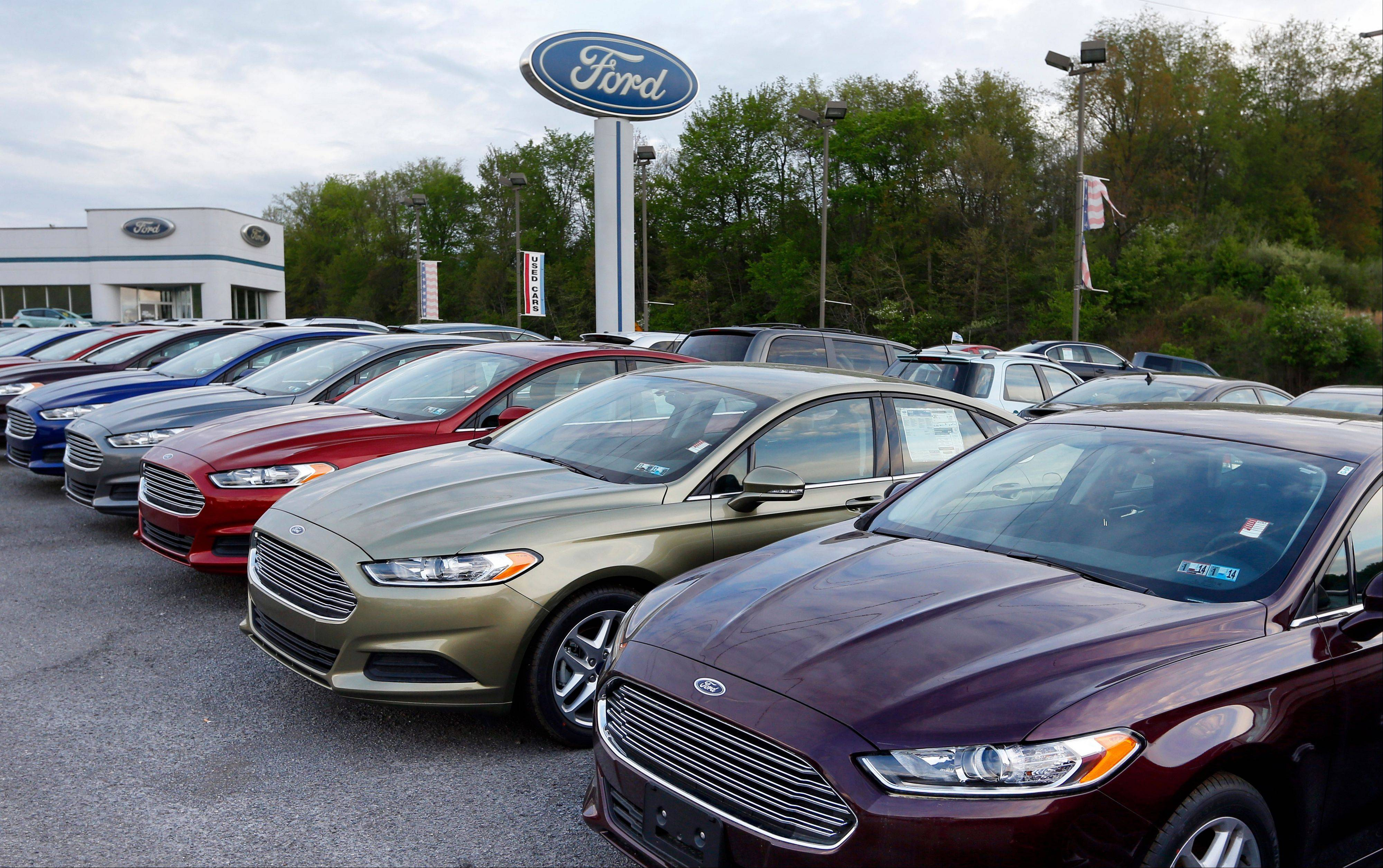 New 2013 Ford Fusions at an automobile dealer in Zelienople, Pa. U.S. buyers snapped up new cars and trucks in June at a pace not seen since before the recession. Continuing demand for big pickups helped boost sales for Detroit's automakers. Ford said Tuesday that its sales rose 14 percent,