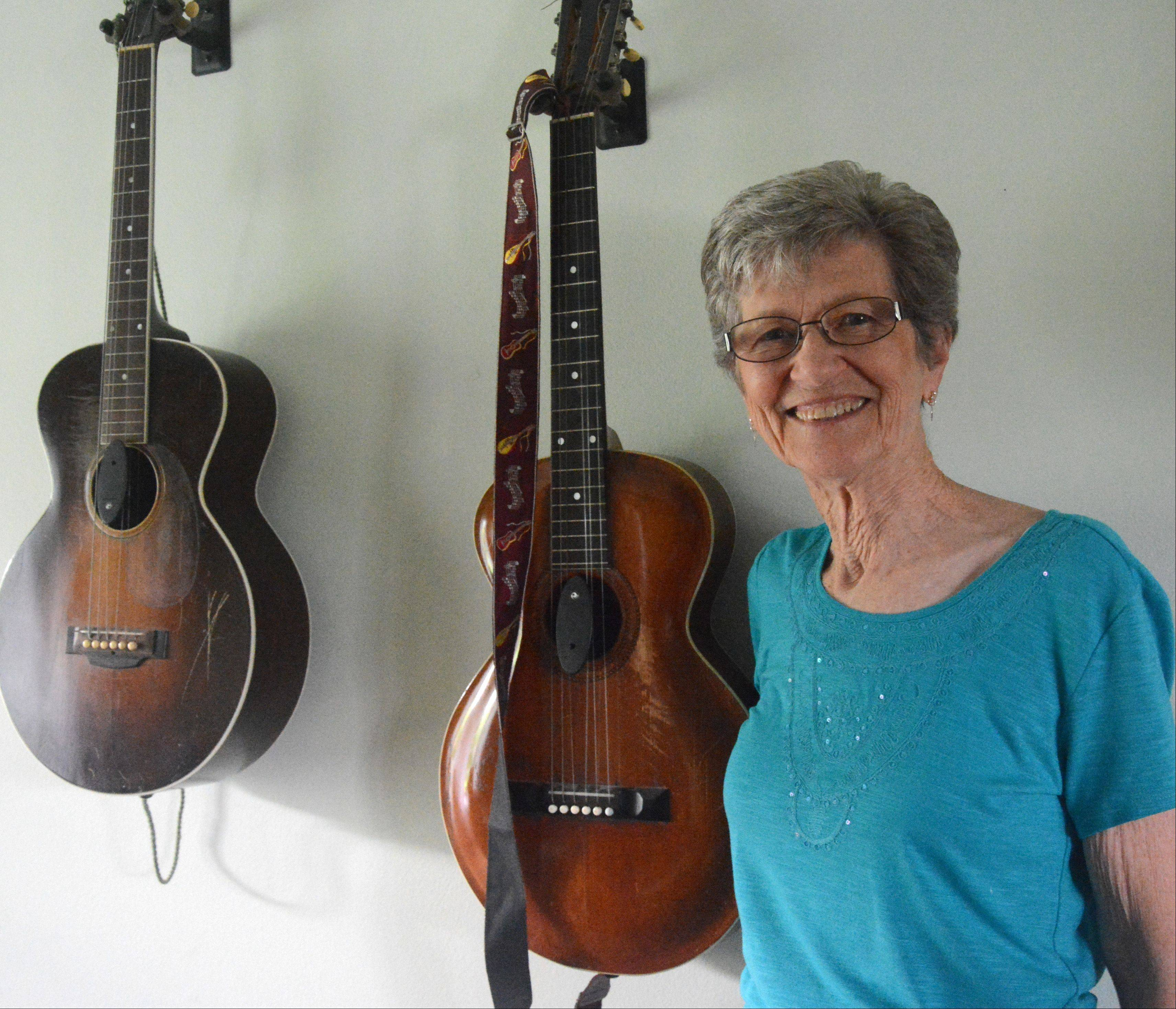 "Saying she used to ""mess around"" with her mother's old guitar, Marge Weber really made progress after taking some guitar classes. The 79-year-old Elk Grove Village grandmother just came out with her first CD of folk songs."