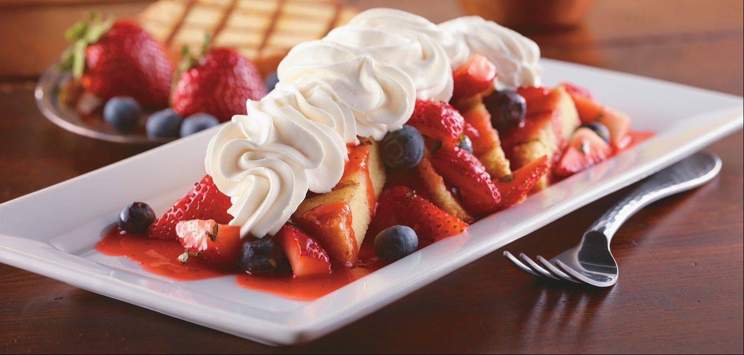 The very berry pound cake, a grilled lemon cake topped with fresh blueberries, strawberries and whipped cream.