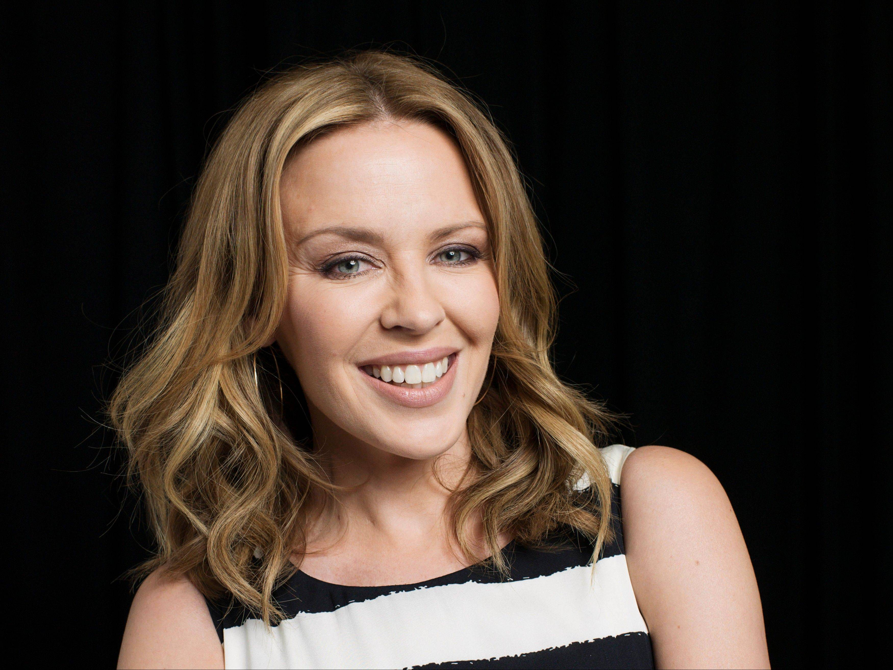 "Australian recording artist Kylie Minogue has compiled a book looking back at her fashion choices, particularly her stage costumes, in a new book called ""Kylie Fashion,"" published by Running Press."