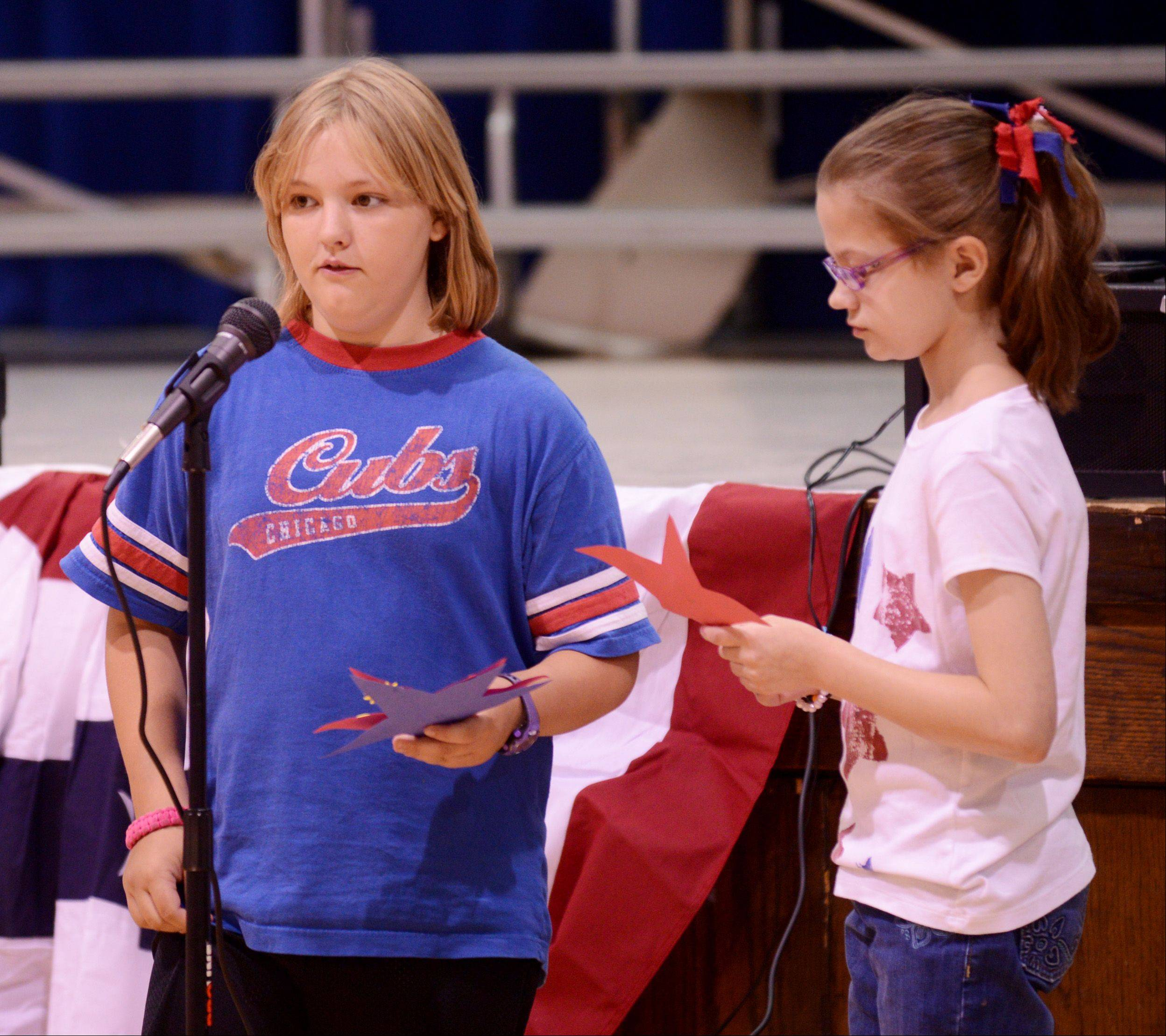 Danielle Kuklewski and Allison Sangorska, read thoughts about freedom and being an American, during an assembly at Bower school, in Warrenville, before their 4th of July parade, Tuesday.