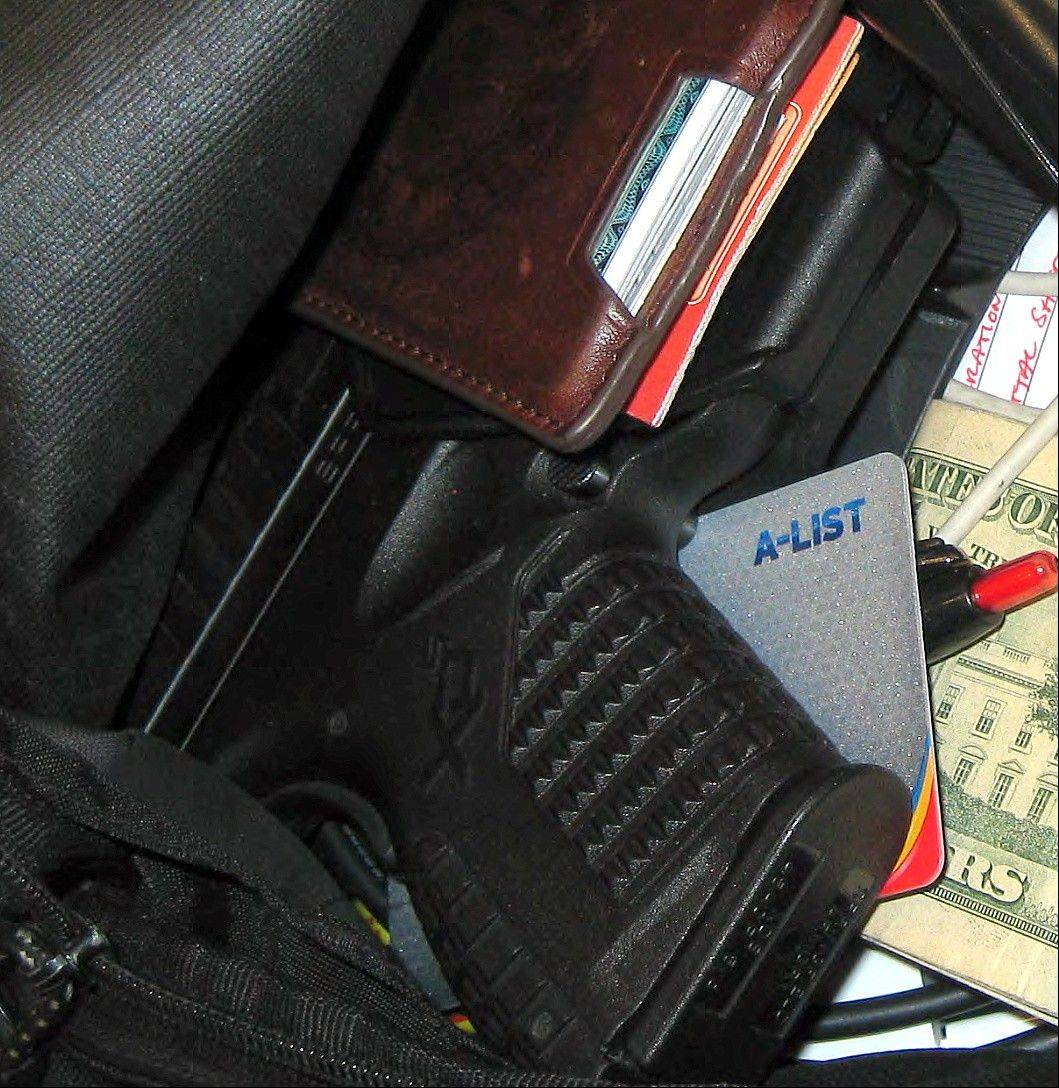 A gun is seen among the personal belongings confiscated in a carry-on bag at Indianapolis International Airport in April.