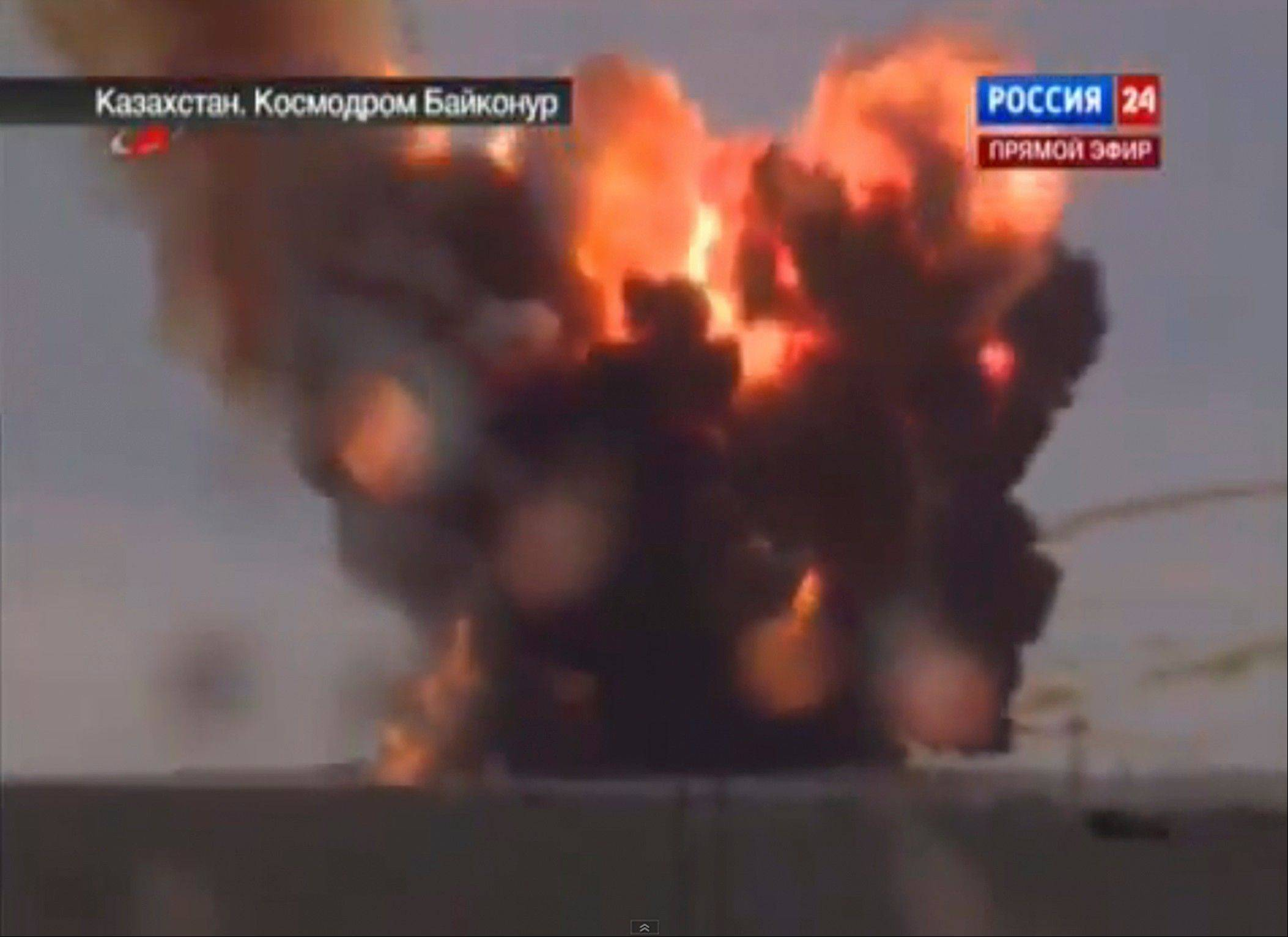 In this frame grab made from TV footage distributed by Russian Vesti 24 channel, Russian booster rocket carrying three satellites crashes at a Russia-leased cosmodrome in Kazakhstan on Tuesday July 2, 2013 shortly after the launch The Proton-M booster unexpectedly shut down the engine 17 seconds into the flight and crashed over a mile away from the Baikonur launchpad, the Russian Space Agency said in a statement.