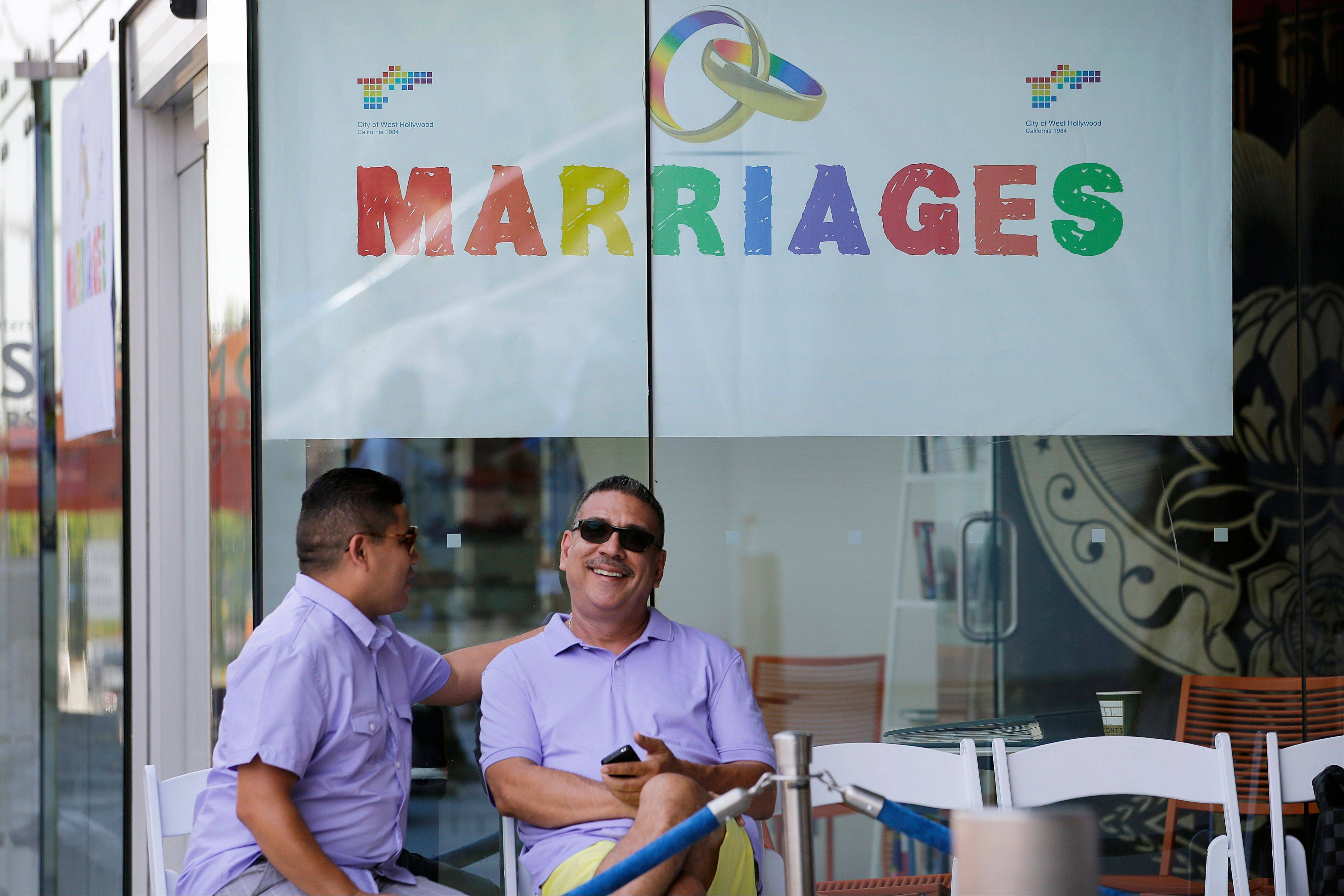 Jose Guerrero, left, and Patrick Rodriguez chat before their wedding ceremony in West Hollywood, Calif., Monday, July 1, 2013. The city of West Hollywood is offering civil marriage ceremonies for same-sex couples free Monday.