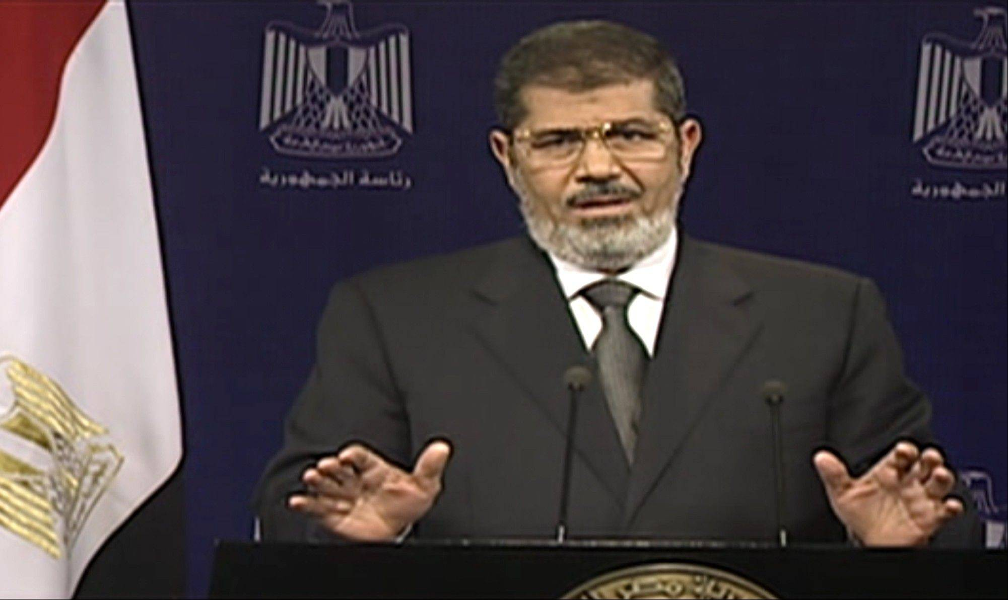 This image made from video broadcast on Egyptian State Television shows President Mohammed Morsi addressing the nation in a televised speech on Tuesday. With the clock ticking, Egypt's besieged president said Tuesday that he will not step down as state media reported that the powerful military plans to overturn his Islamist-dominated government if the elected leader doesn't meet the demands of the millions of protesters calling for his ouster.