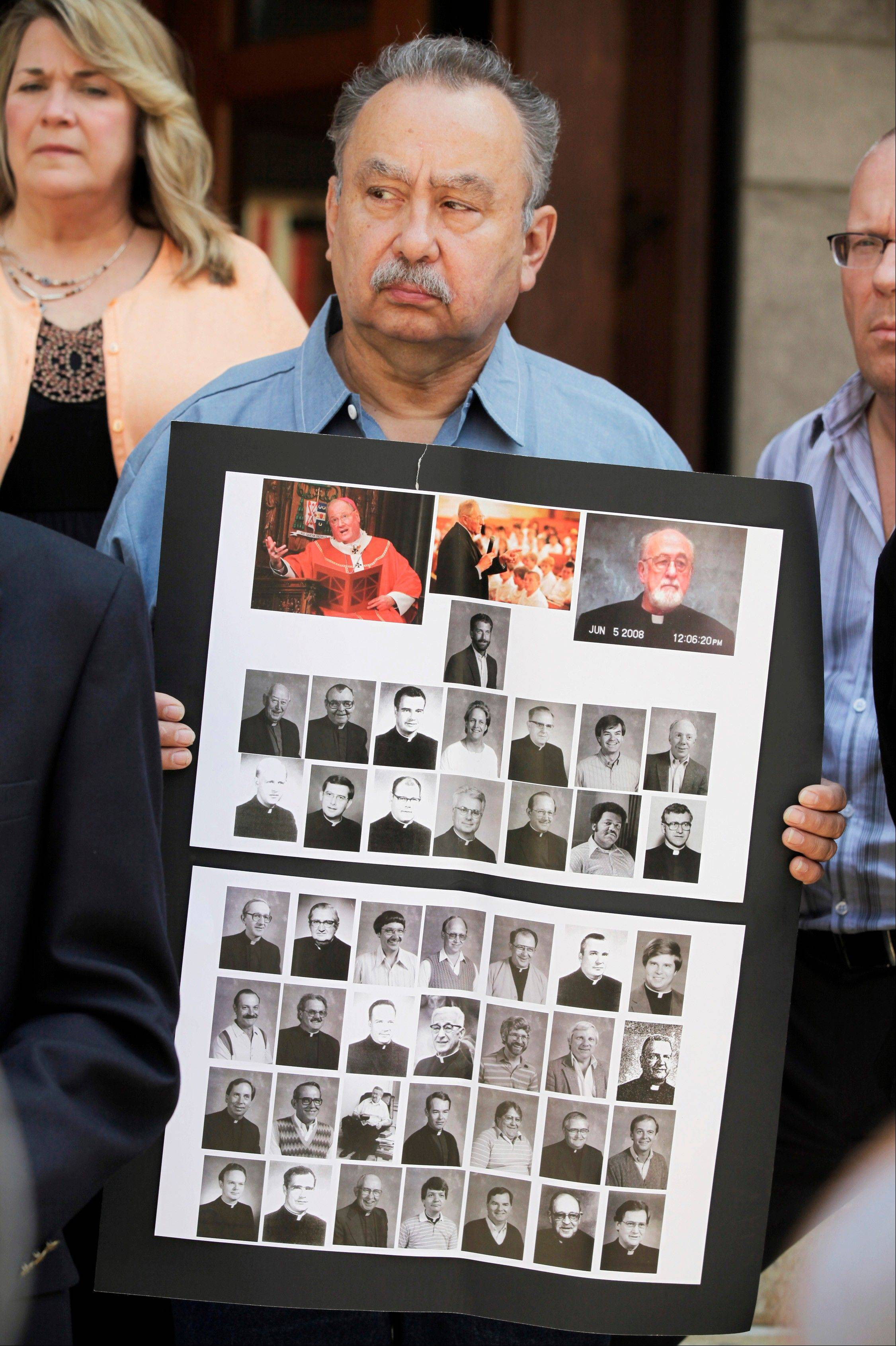 Arthur Budzinaki holds a poster of the 45 priests named on the archdiocese's website as having substantiated allegations of sexually abusing at least one minor.