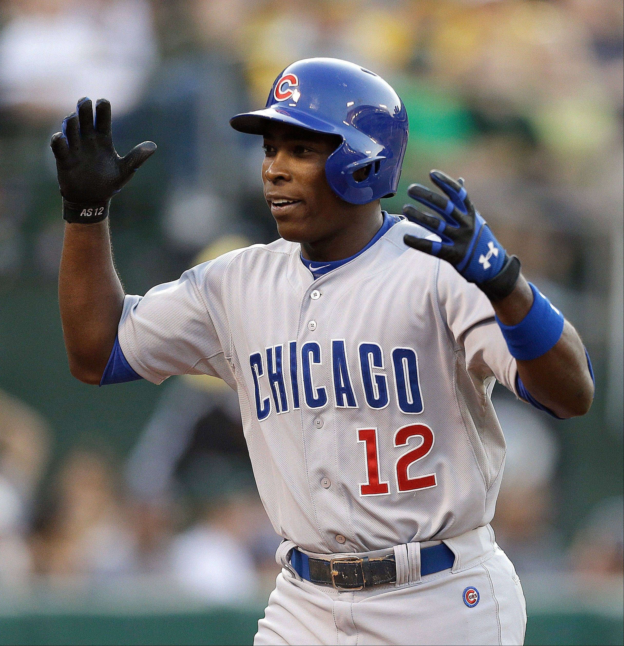 The Cubs' Alfonso Soriano celebrates after hitting a three-run home run off Oakland's A.J. Griffin in the fourth inning Tuesday night.