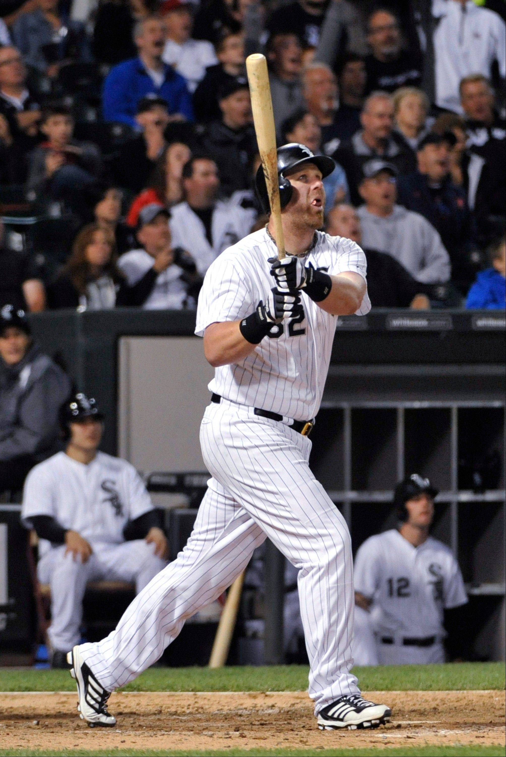 Chicago White Sox's Adam Dunn watches his two-run home run against the Baltimore Orioles during the seventh inning of a baseball game, Tuesday, July 2, 2013, in Chicago.
