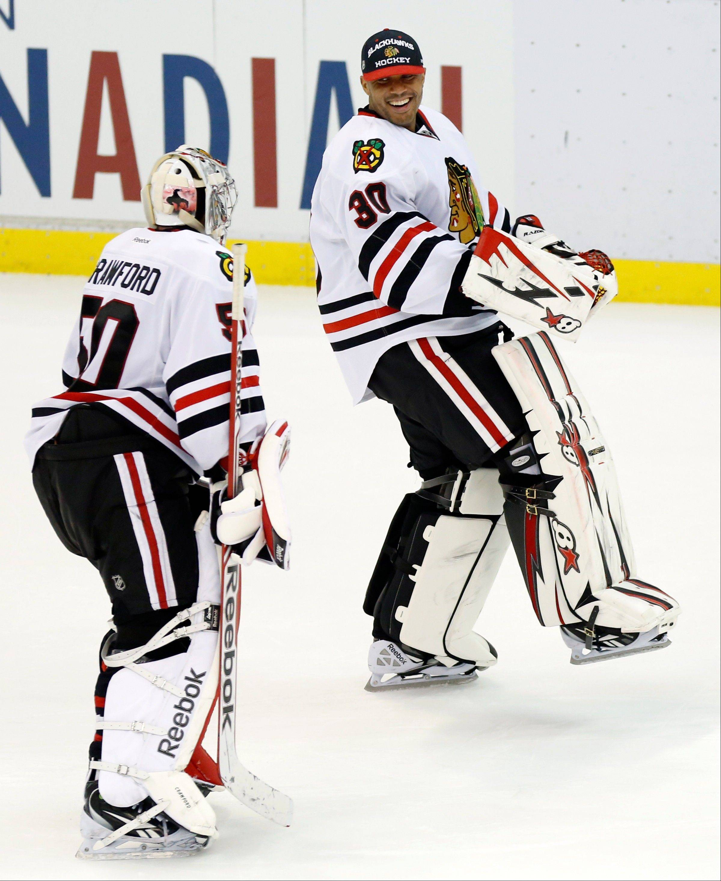 Goalies Ray Emery, right, and Corey Crawford share a laugh after a Blackhawks victory in March.