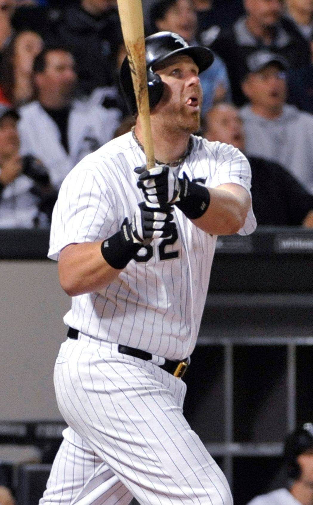 Adam Dunn watches his two-run home run in the seventh inning of the White Sox' victory over Baltimore on Tuesday.