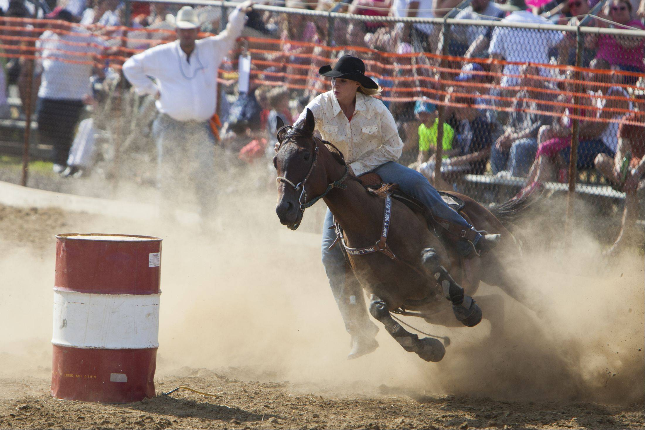 Jamie Gellman of Wauconda rounds a barrel during last year's Wauconda rodeo.