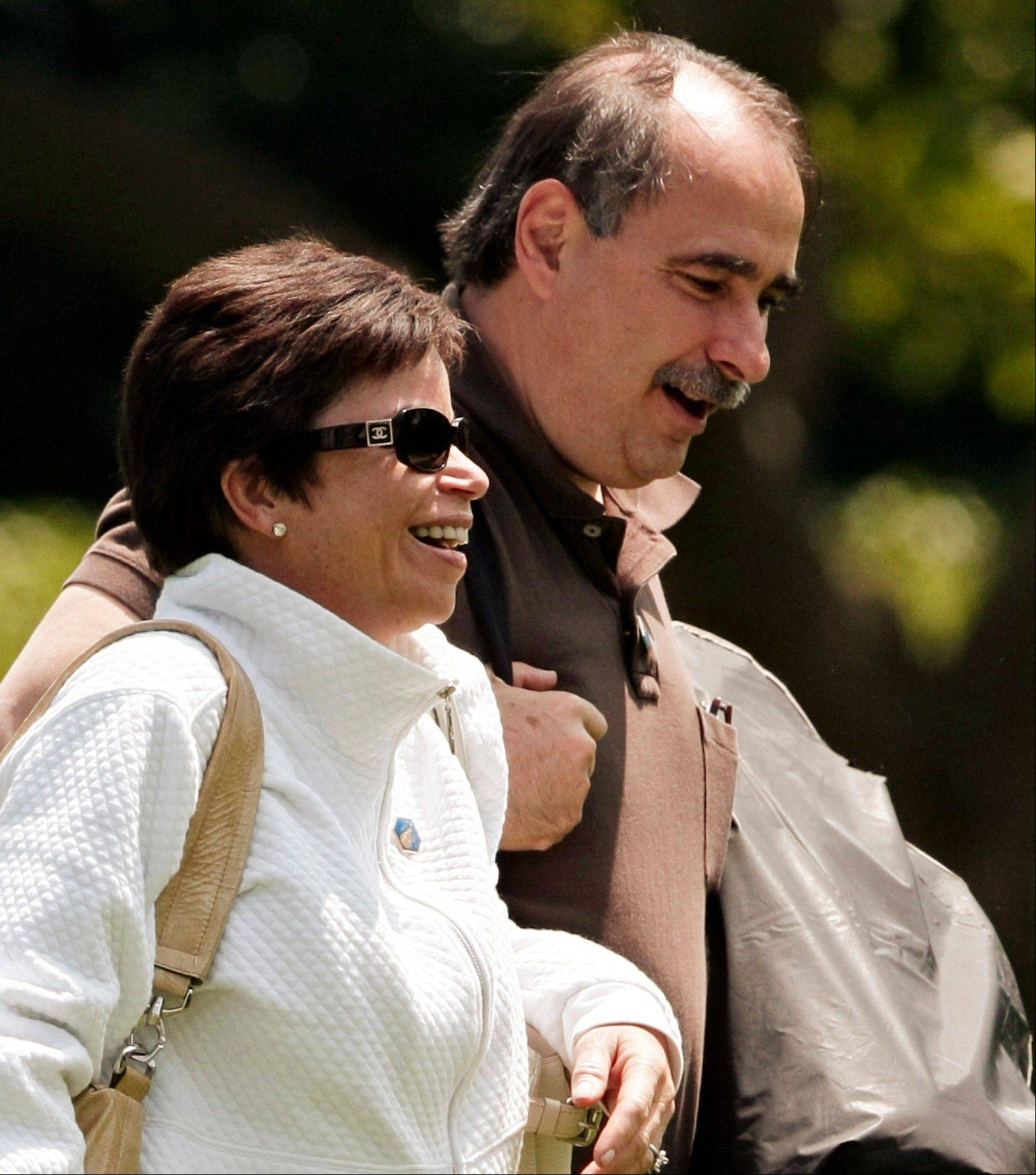 In this June 7, 2009, photo, senior advisers Valerie Jarret and David Axelrod, right, walk across the South Lawn of the White House after returning from a trip with President Barack Obama. The Obama administration Tuesday unexpectedly announced a one-year delay, until 2015, in a central requirement of the new health care law that medium and large companies provide coverage for their workers or face fines.