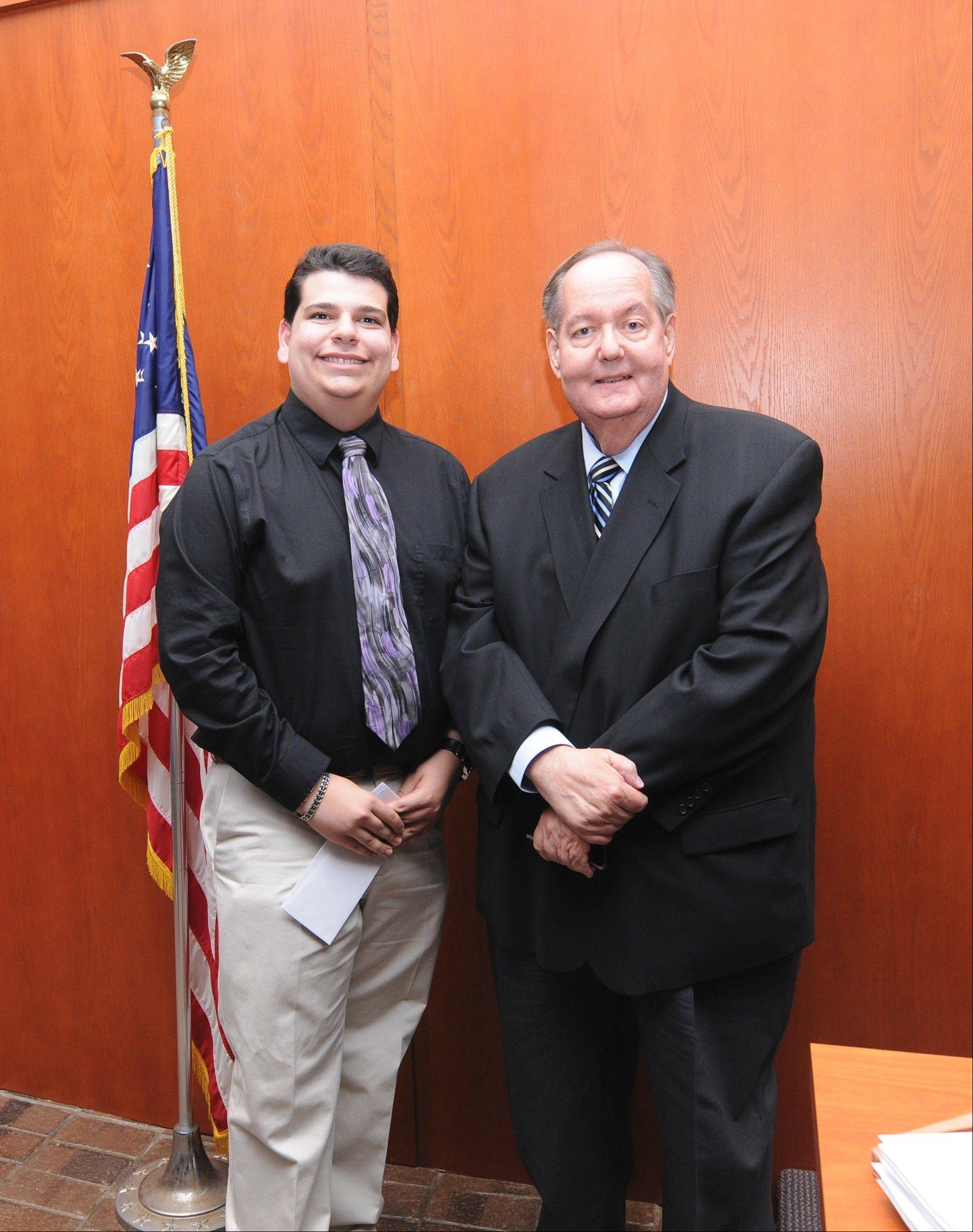 Kelliher-Lawless Scholarship recipient Jason Brescia of Hoffman Estates, left, with Schaumburg Trustee George Dunham.