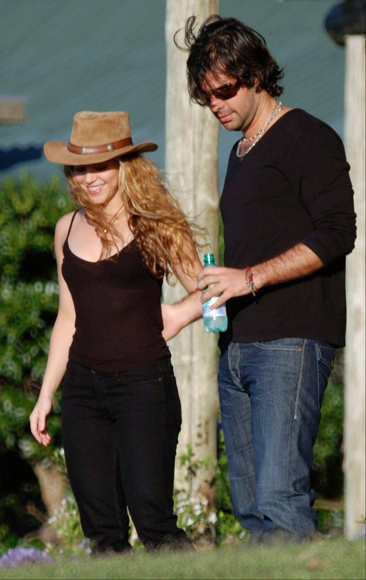 "In this Dec. 18, 2008 file photo, Colombian pop singer Shakira, left, walks with Antonio De La Rua at her farm ""La Colorada"" in Jose Ignacio, Uruguay. A judge in Geneva has rejected a request from Shakiraís ex-boyfriend, De La Rua, seeking access to one of the singerís bank accounts. In documents dated June 17, 2013, and obtained by The Associated Press, the judge said Shakira is the account's sole owner."