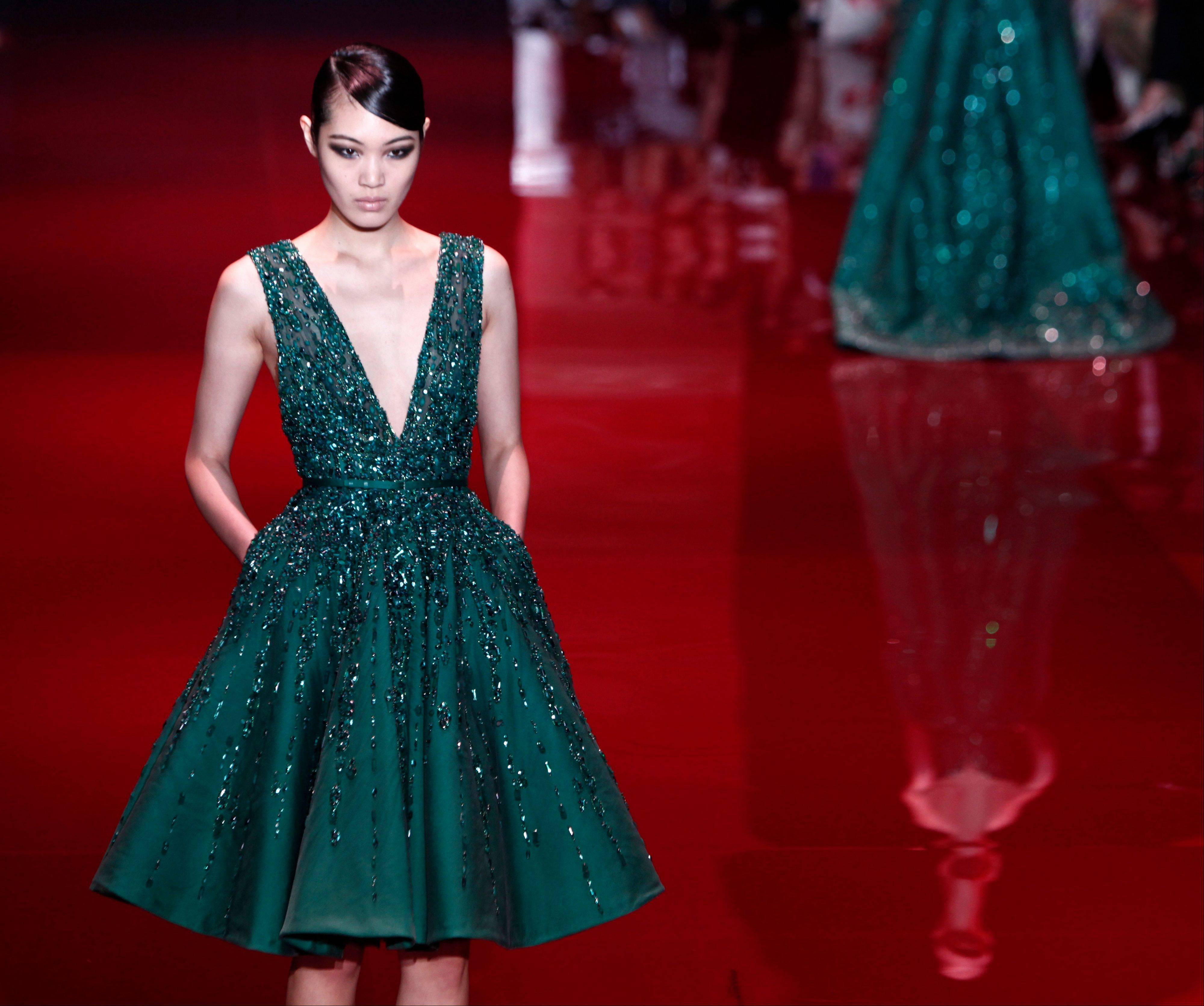 A model wears a creation for Lebanese fashion designer Elie Saab's Haute Couture Fall-Winter 2013-2014 collection presented Wednesday, July 3, 2013 in Paris.
