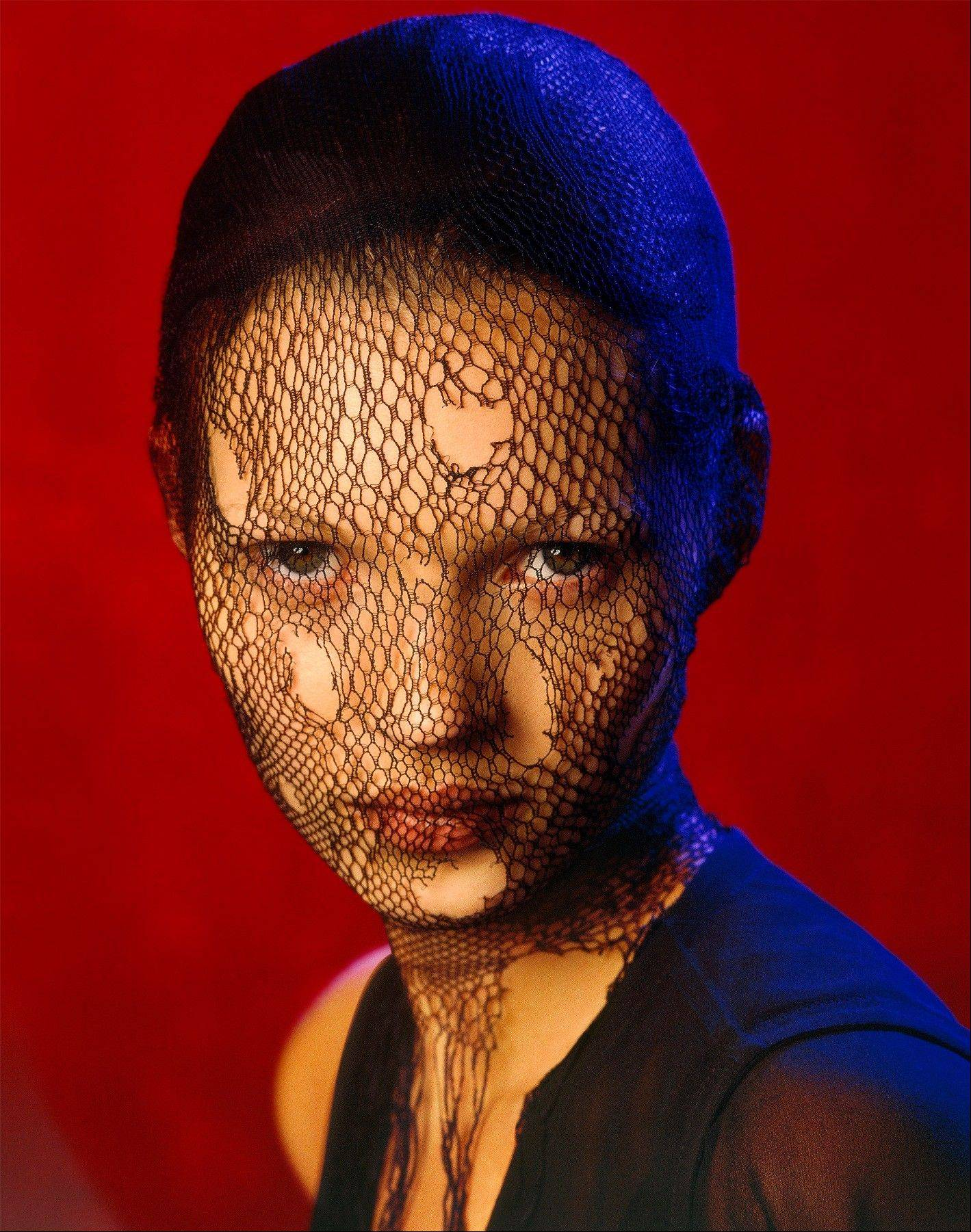 This image made available by Christie's auction house on Wednesday July 3, 2013 shows an image of British model Kate Moss, 'Kate Moss in Torn Veil', Marrakech, 1993 by Albert Watson. Few people have been photographed more often than Kate Moss, and some of the most famous images of the supermodel are going under the hammer at a Christie's auction in London on Sept. 25.