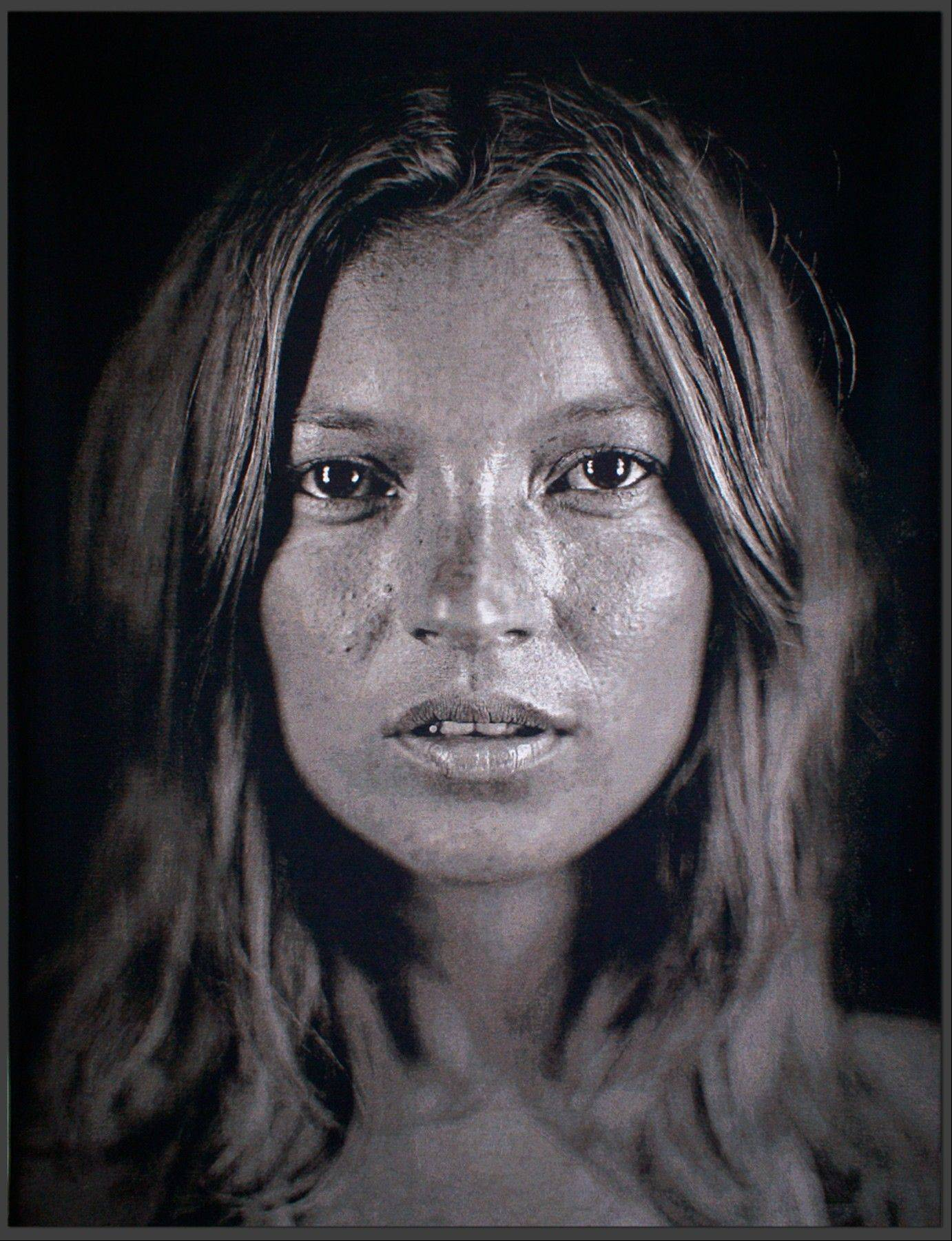 This image made available by Christie's auction house on Wednesday July 3, 2013 shows an image of British model Kate Moss, 'Kate', 2007 by Chuck Close. Few people have been photographed more often than Kate Moss, and some of the most famous images of the supermodel are going under the hammer at a Christie's auction in London on Sept. 25.