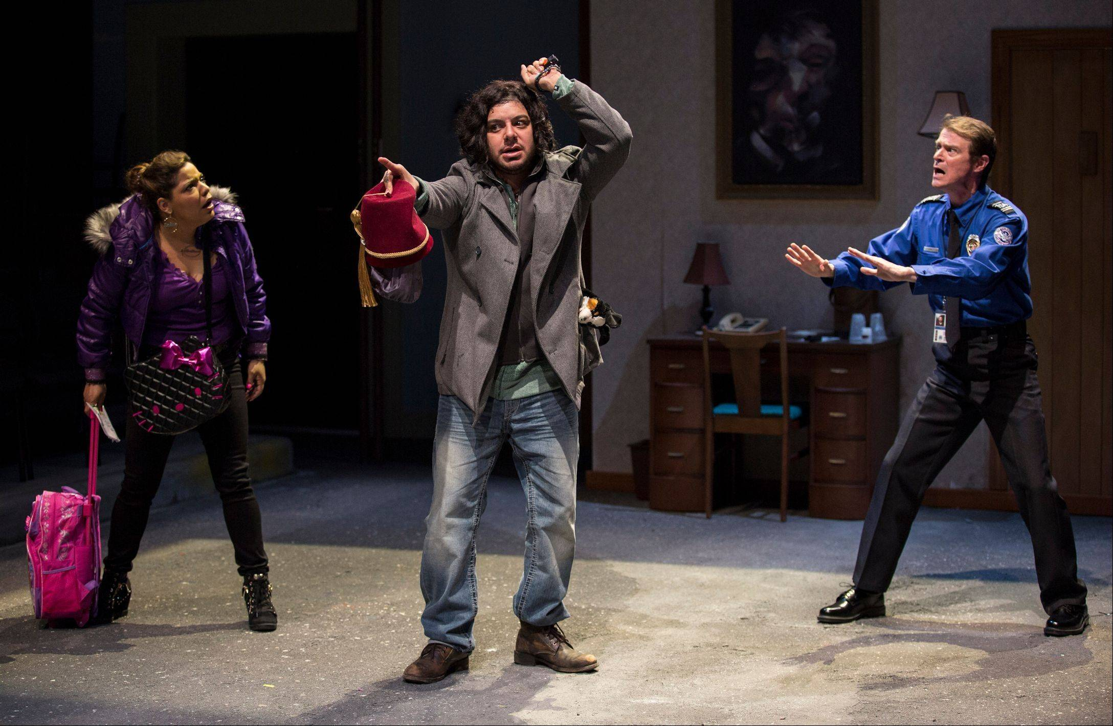"Stewart Perez (Eddie Martinez), center, threatens to remove a screwdriver from his skull in ""Big Lake Big City"" by Arlington Heights playwright Keith Huff. David Schwimmer directs Lookingglass Theatre's world premiere featuring Wendy Mateo as Stewart's girlfriend and Thomas J. Cox as an O'Hare security guard."