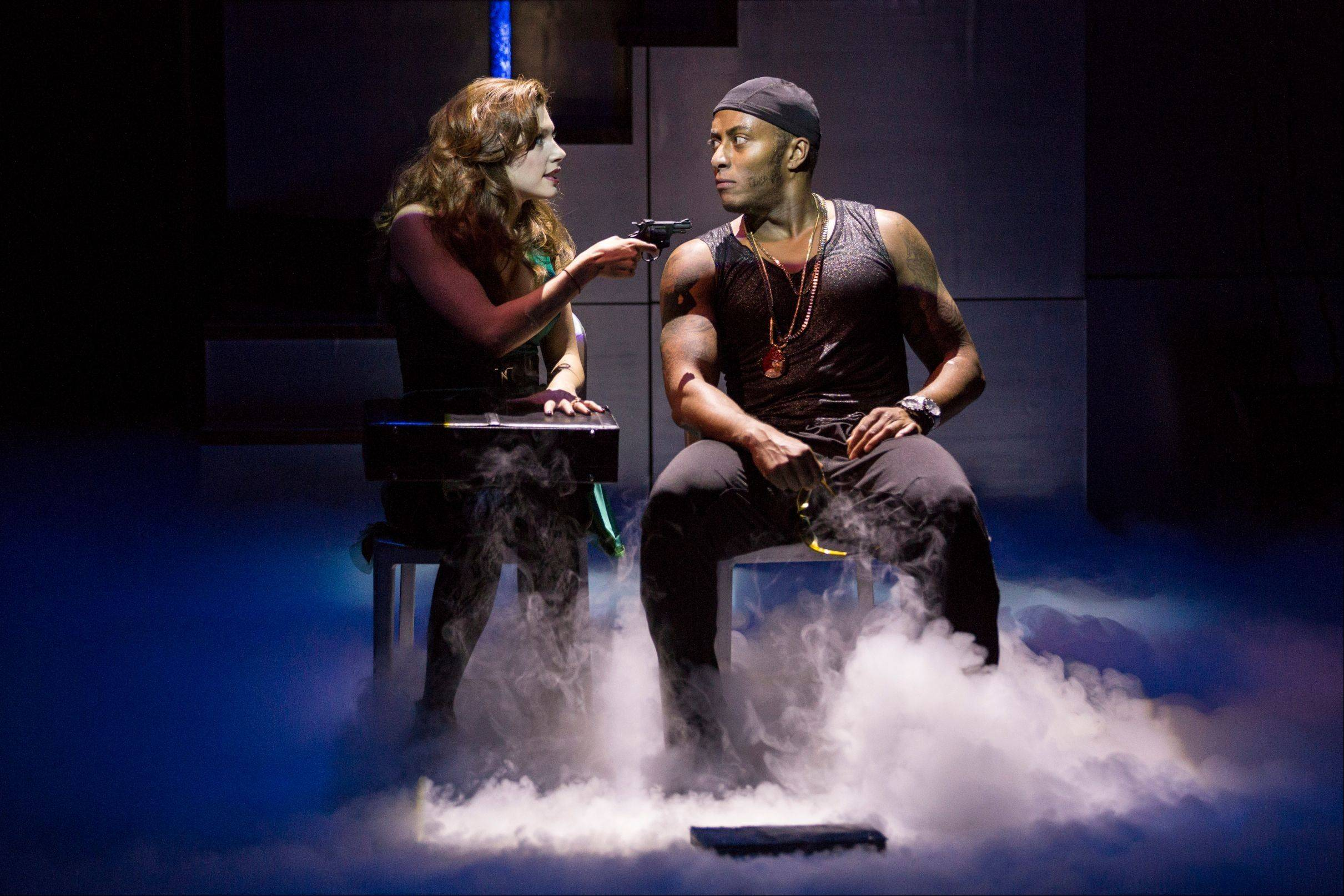 "Recently exonerated convict Elston Moss (Anthony Fleming III) has a difference of opinion with his ex-girlfriend Ally (Katherine Cunningham) in Lookingglass Theatre Company's world premiere of Keith Huff's noir crime dramedy ""Big Lake Big City."""
