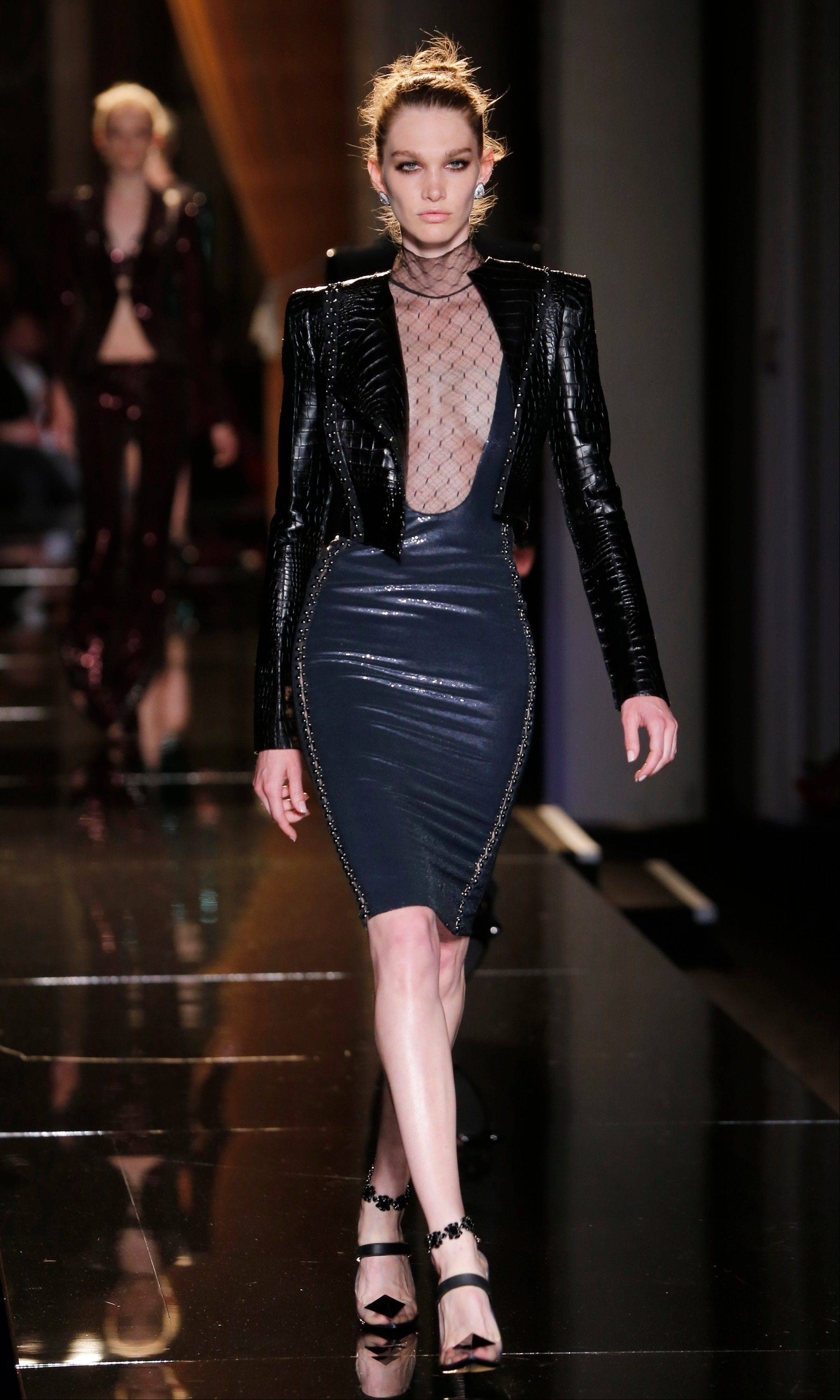 A model wears a creation by fashion designer Donatella Versace during her Women's Fall Winter 2013 haute couture fashion collection in Paris, France.