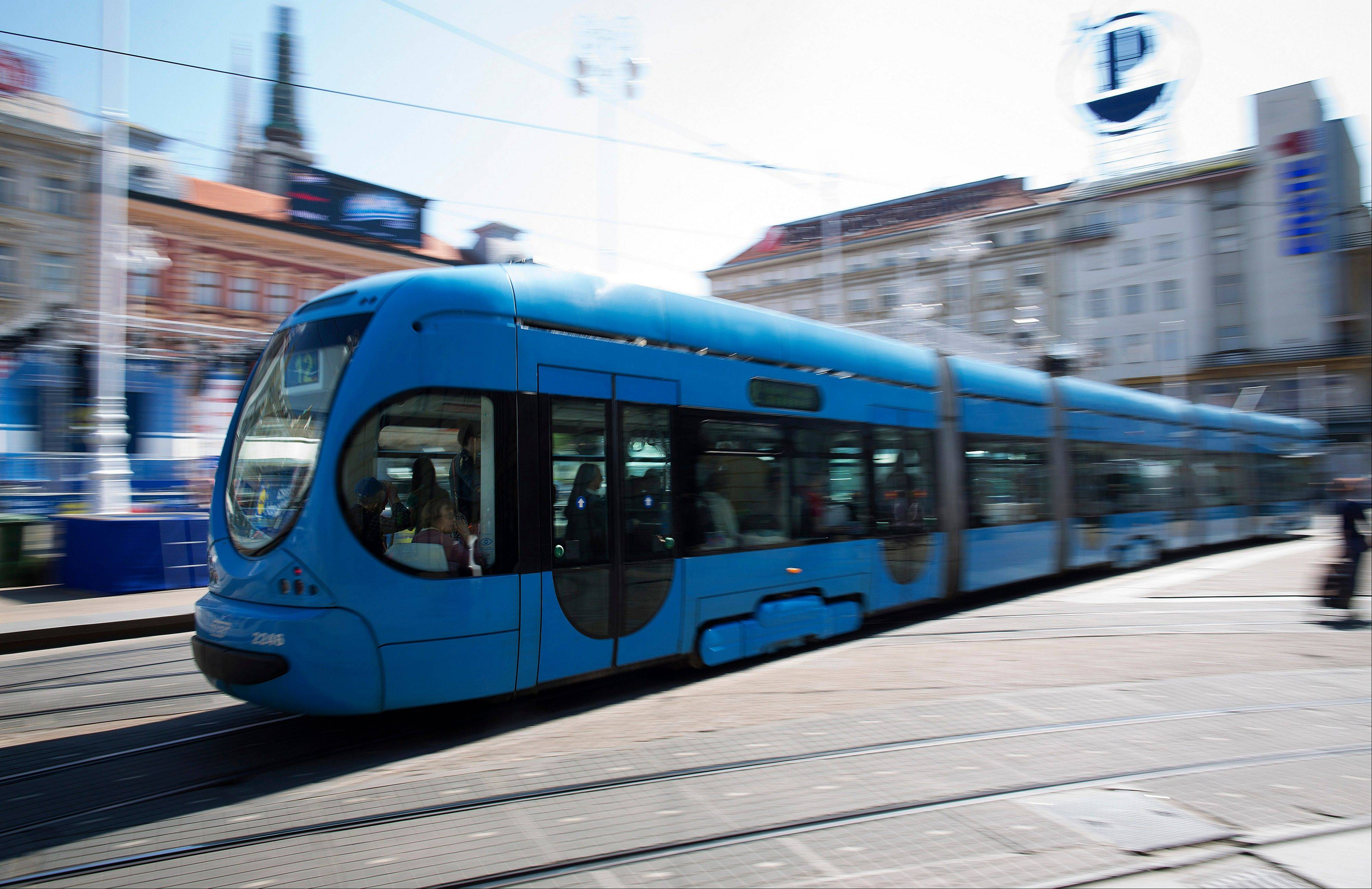 Commuters travel on a tram as it crosses Bana Jelacic Square in Zagreb, Croatia. Croatia will become the EU's 28th member next week as the world's largest trading bloc expands for the first time since Bulgaria and Romania entered in 2007.