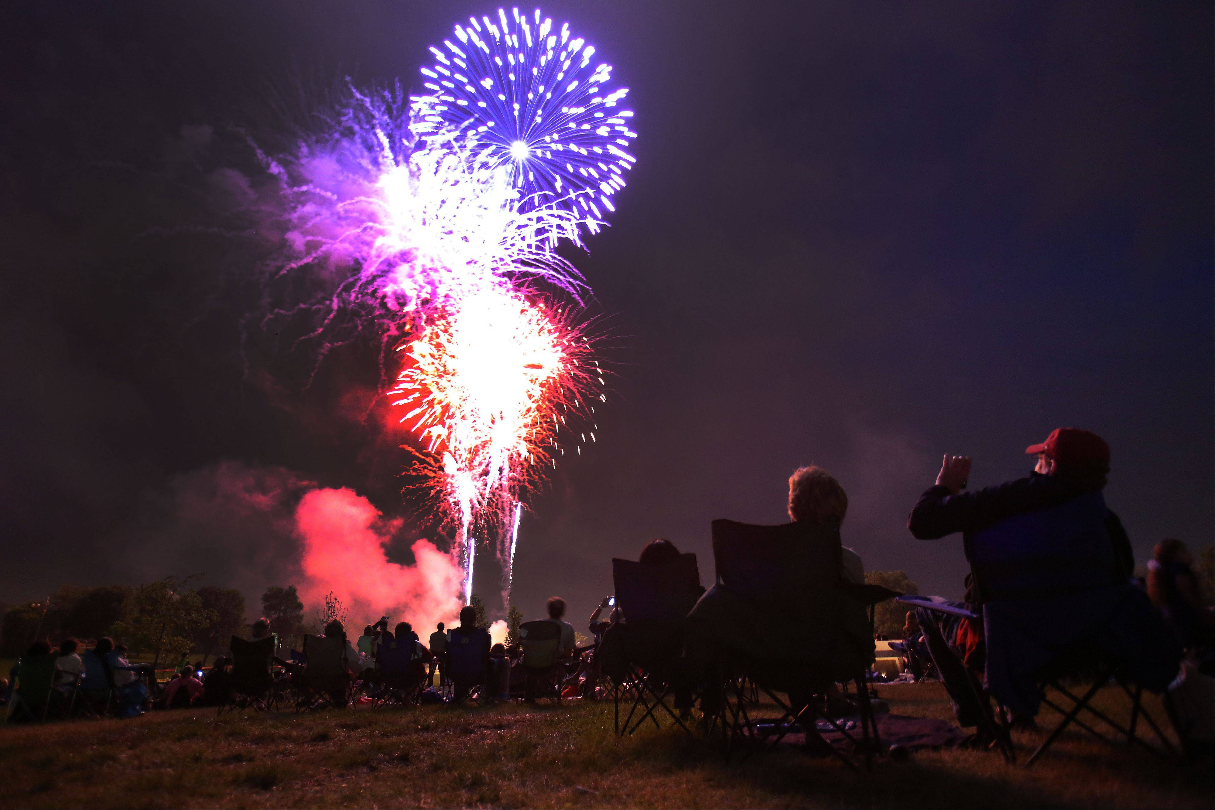 People enjoy the fireworks show Wednesday night at Cook Park in Wauconda.