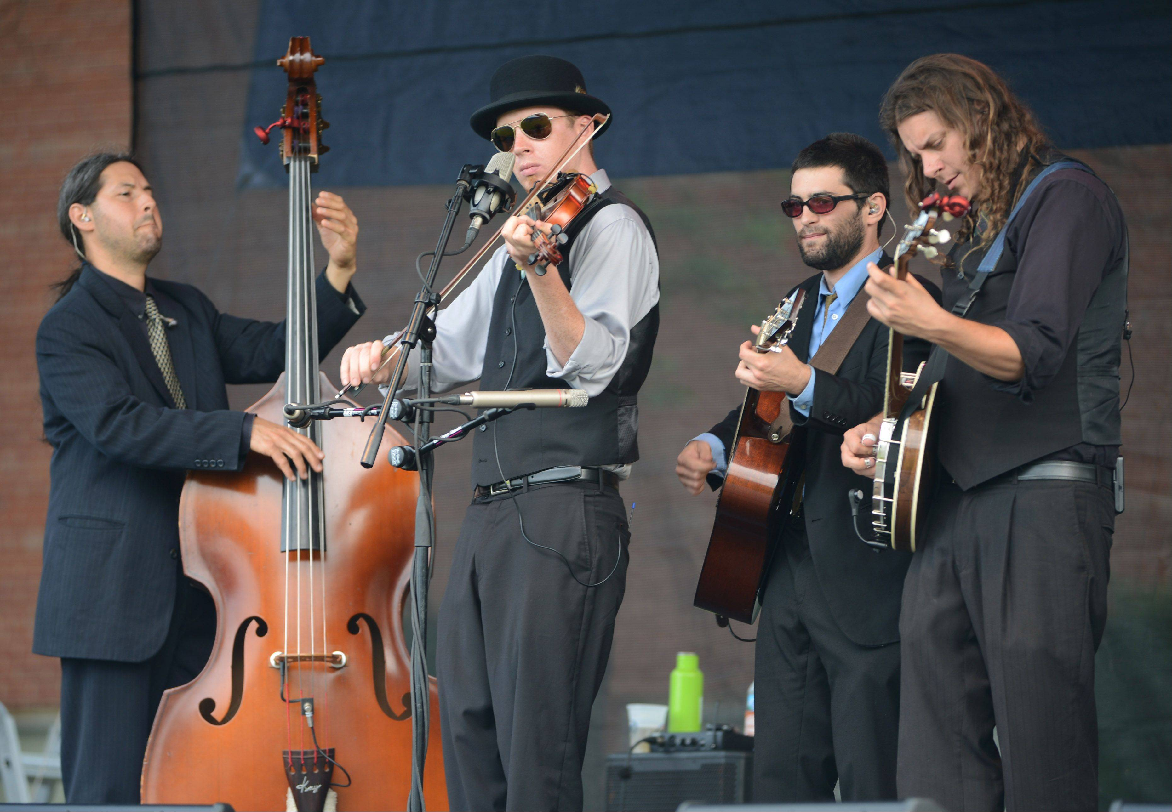 Members of The Henhouse Prowlers of Chicago from left Jon Goldfine, Dan Andree, Star Moss and Ben Wright perform bluegrass music during the Mundelein Community Days Wednesday evening.