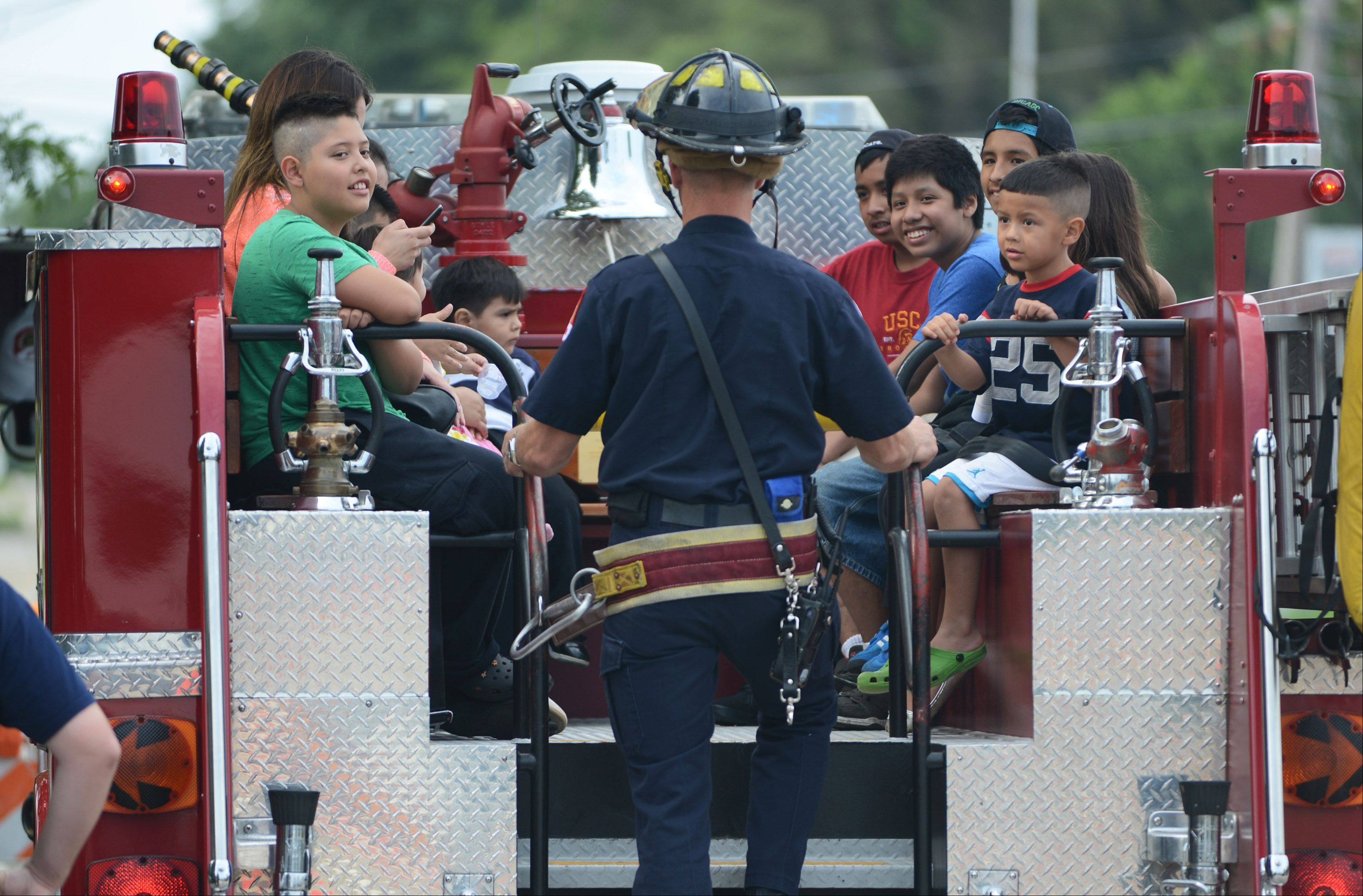 Kids enjoy fire truck rides Wednesday night at Mundelein Community Days.