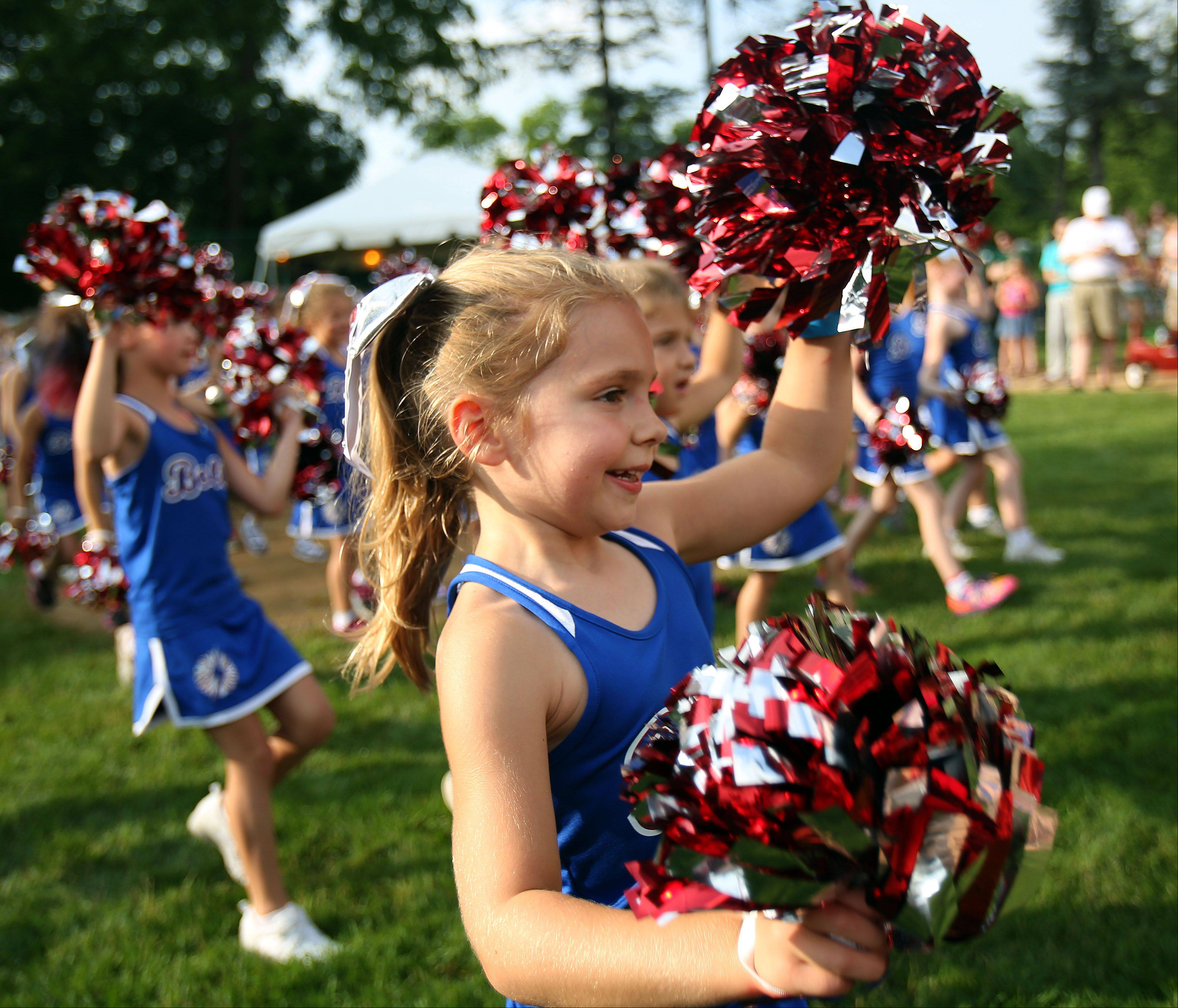 Five-year-old Caroline Gibbs of Lincolnshire and the rest of the Bolts Pom team perform during Lincolnshire's Red, White & Boom celebration Wednesday in Spring Lake Park.