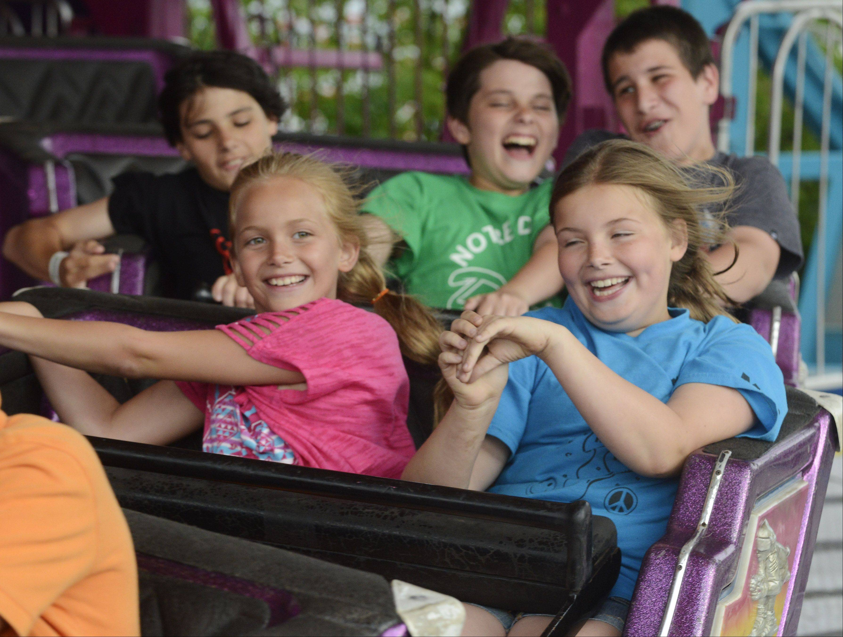 "Mallory Leno, 8, rides ""The Matterhorn"" with her sister, Molly, 10, during Frontier Days in Arlington Heights Wednesday."