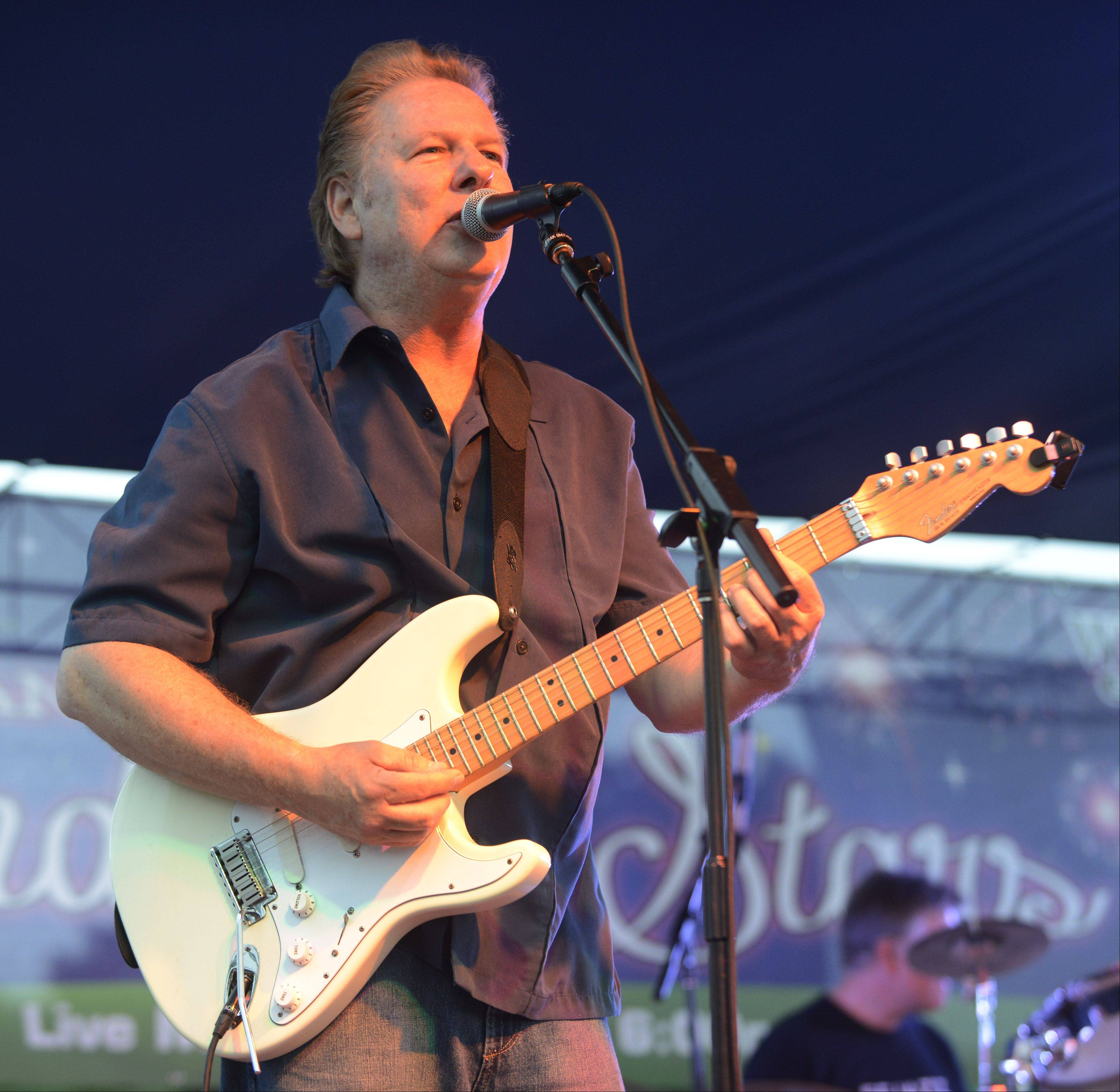 "Harry Reinhart performs with the band ""Midnight"" during a pre-fireworks concert in Wheeling Wednesday evening."
