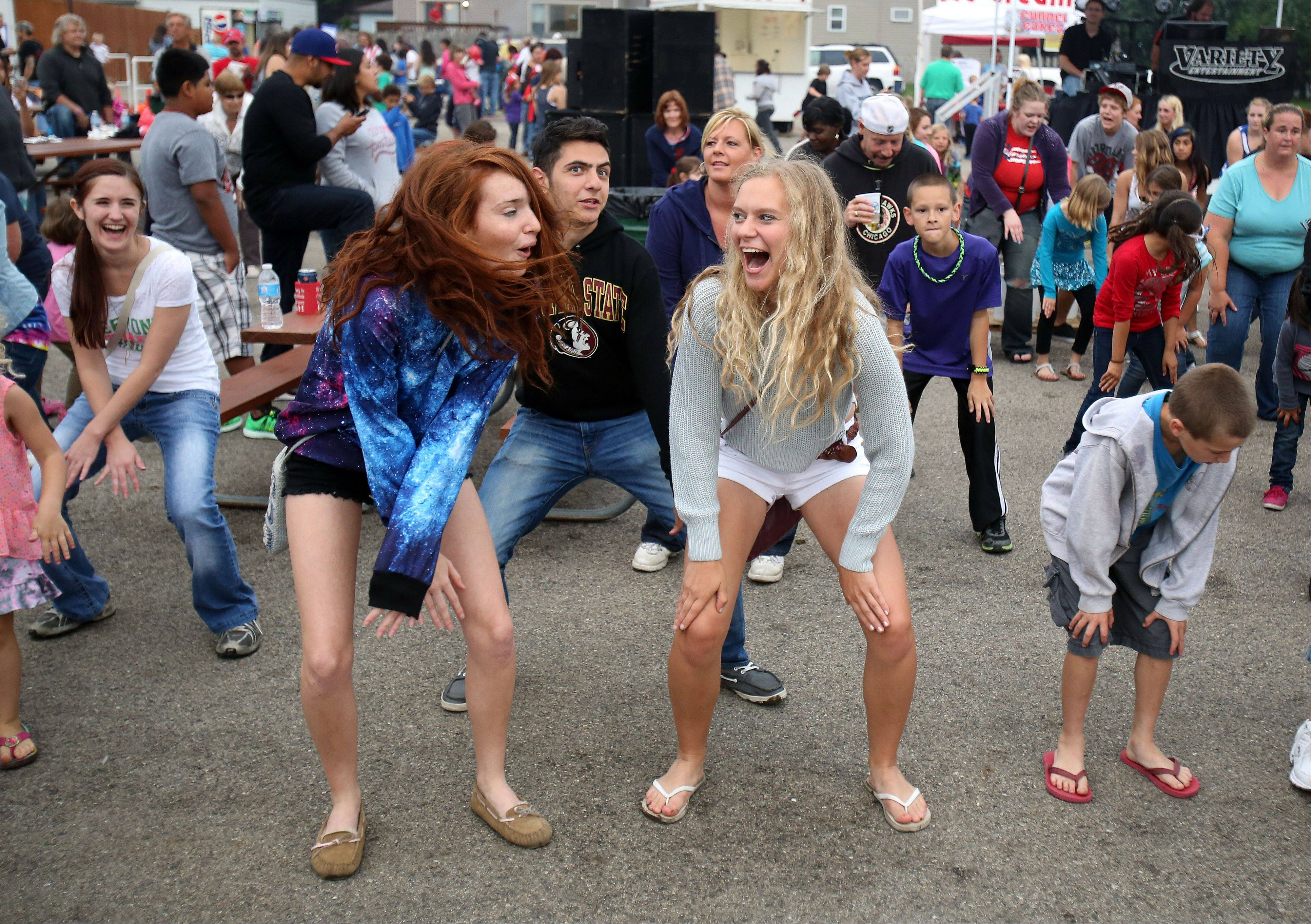Kids do some line dancing as they wait for the fireworks to start at Cook Park in Wauconda Wednesday night.