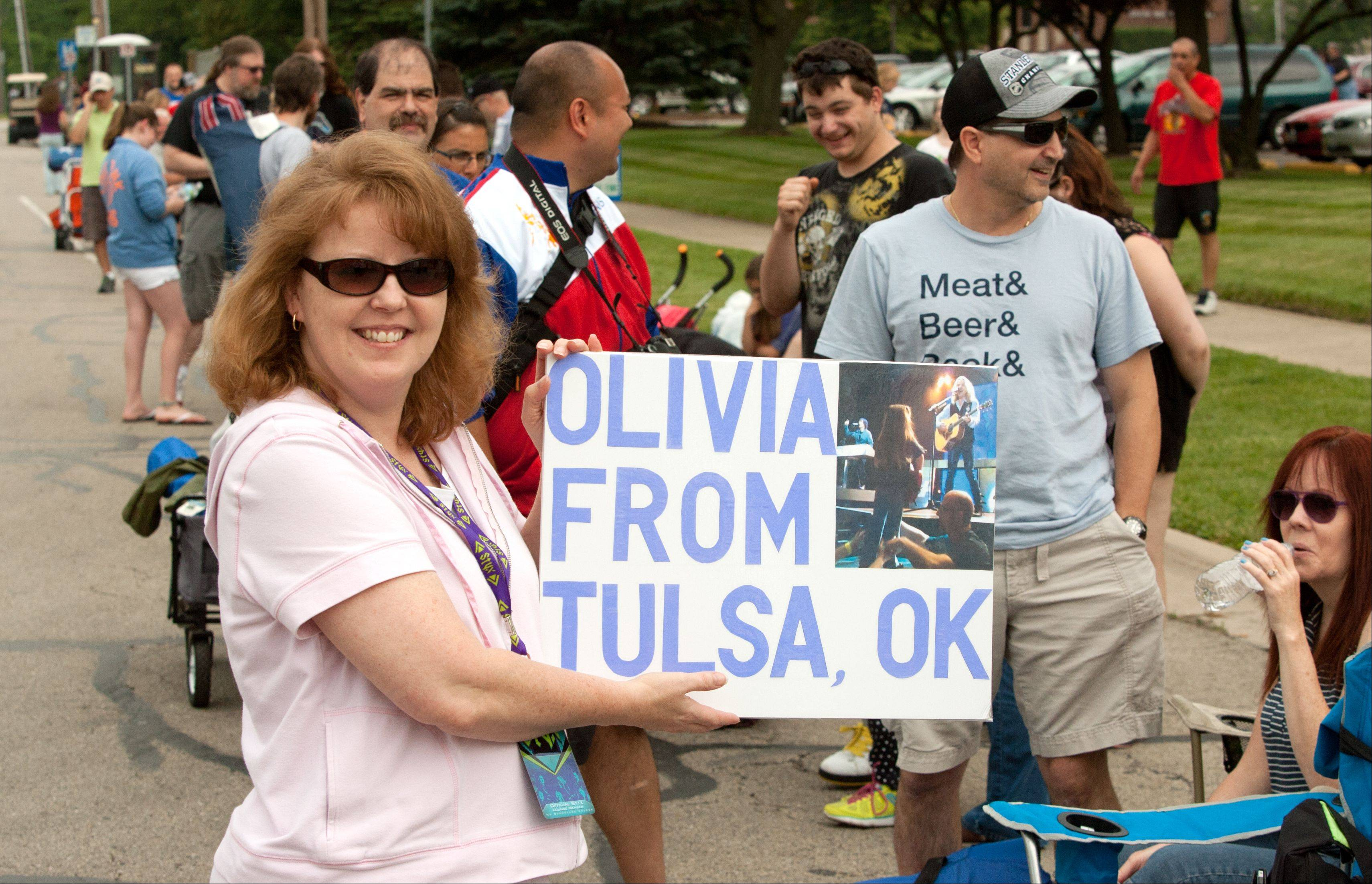 Melony Birt of Tulsa, Okla., stakes out the first spot in line at Ribfest's east gate Wednesday afternoon in Naperville as she waits to celebrate her daughter Olivia's 4th birthday at the Styx concert.
