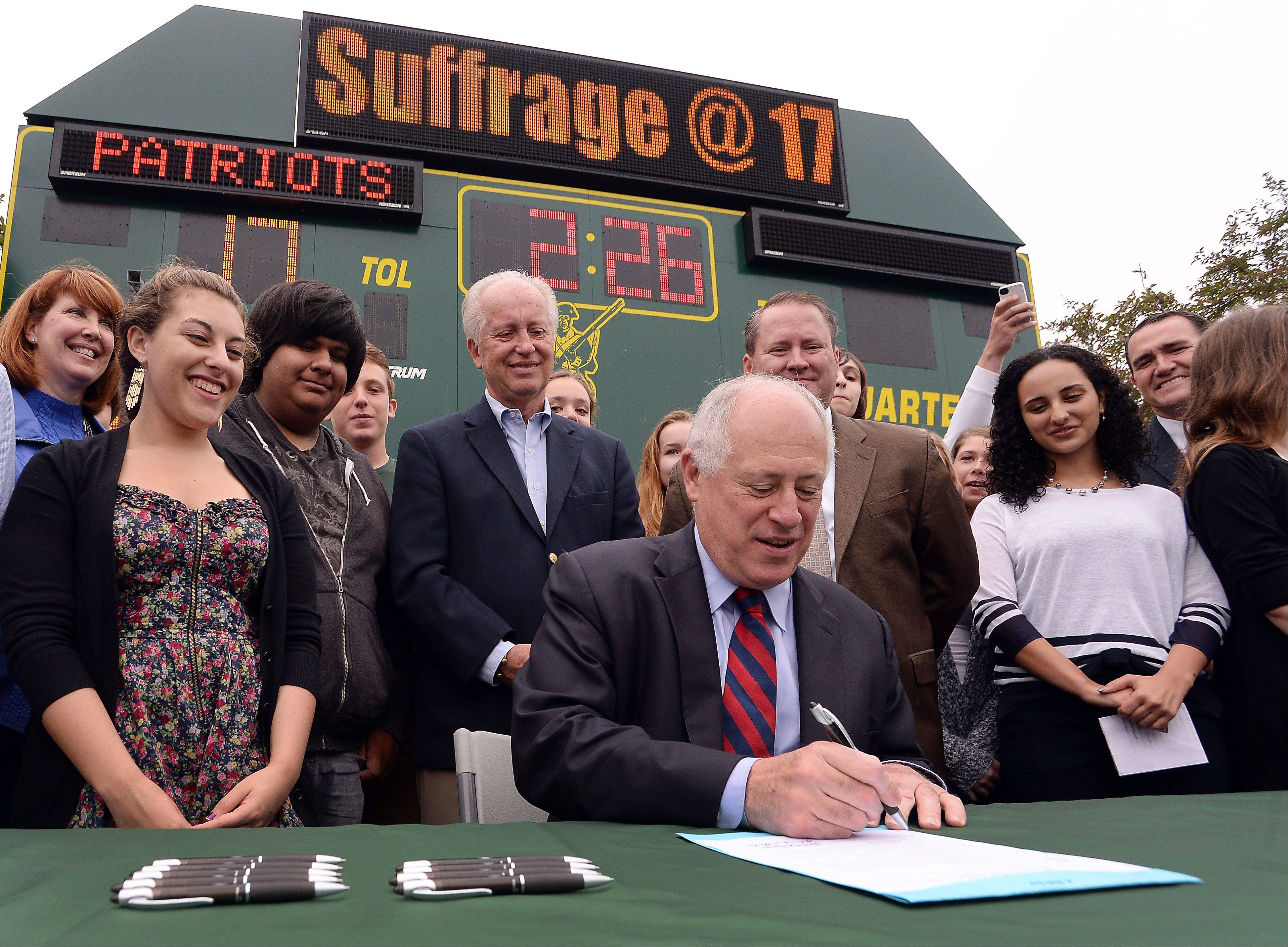 Gov. Pat Quinn signs a bill into law expanding voting rights to some 17-year-olds. Wednesday's bill signing was at Stevenson High School in Lincolnshire.