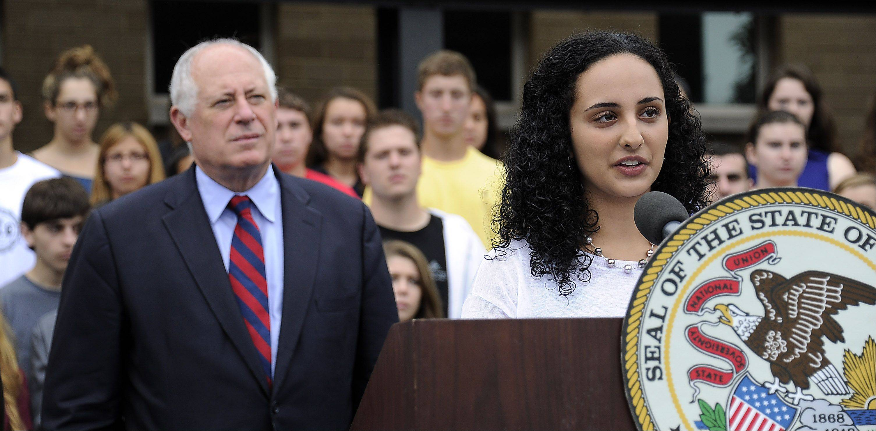 Stevenson High School student Neli Farahmandpour, 17, of Long Grove, talks about the new bill Gov. Pat Quinn will sign into law expanding voting rights to some 17-year-olds. Wednesday's bill signing was at the Lincolnshire school.