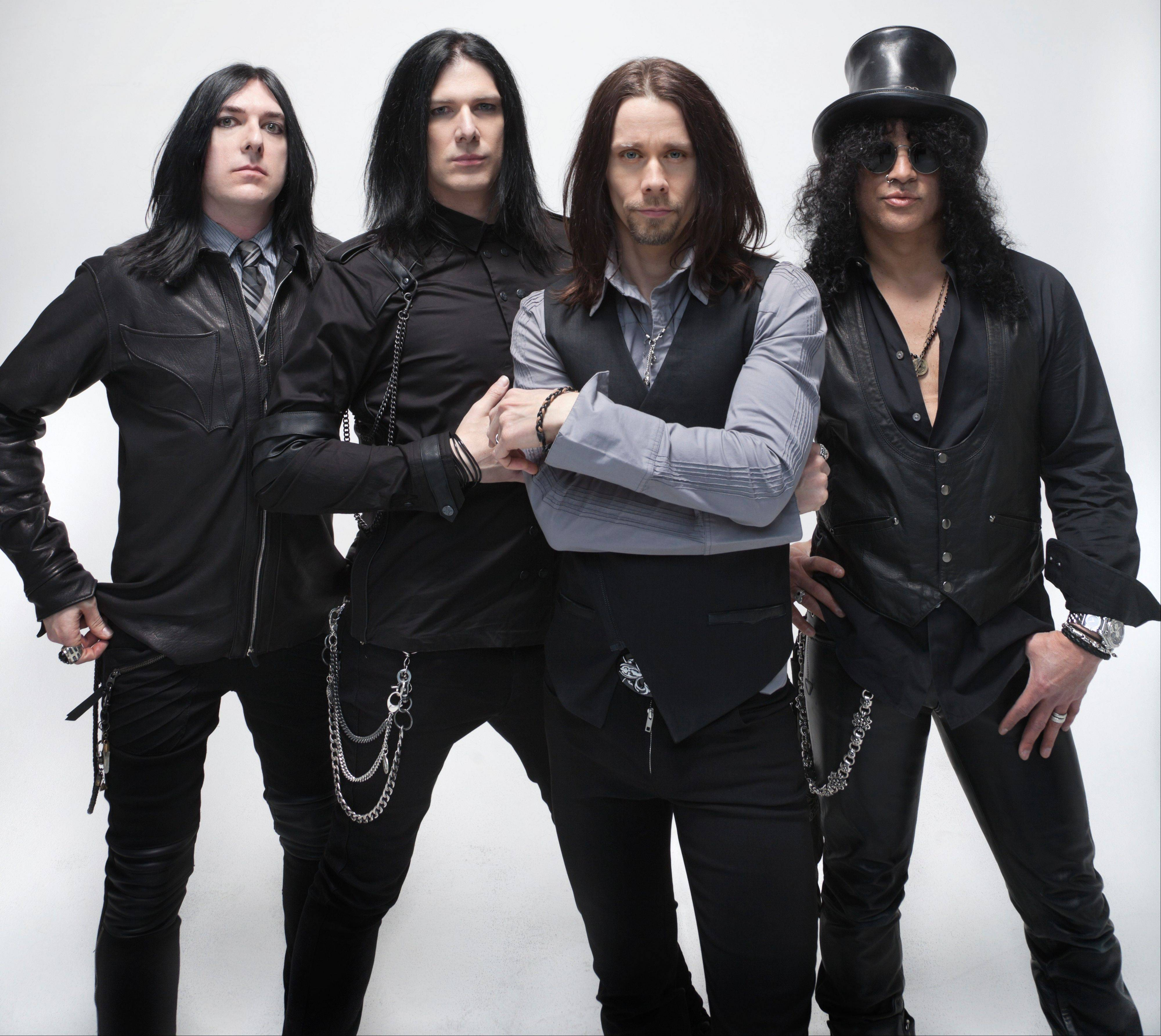 Slash, right, the iconic rock guitarist who used to play with Guns N' Roses, will play with his band Myles Kennedy & the Conspirators at Naperville's Ribfest on Friday.