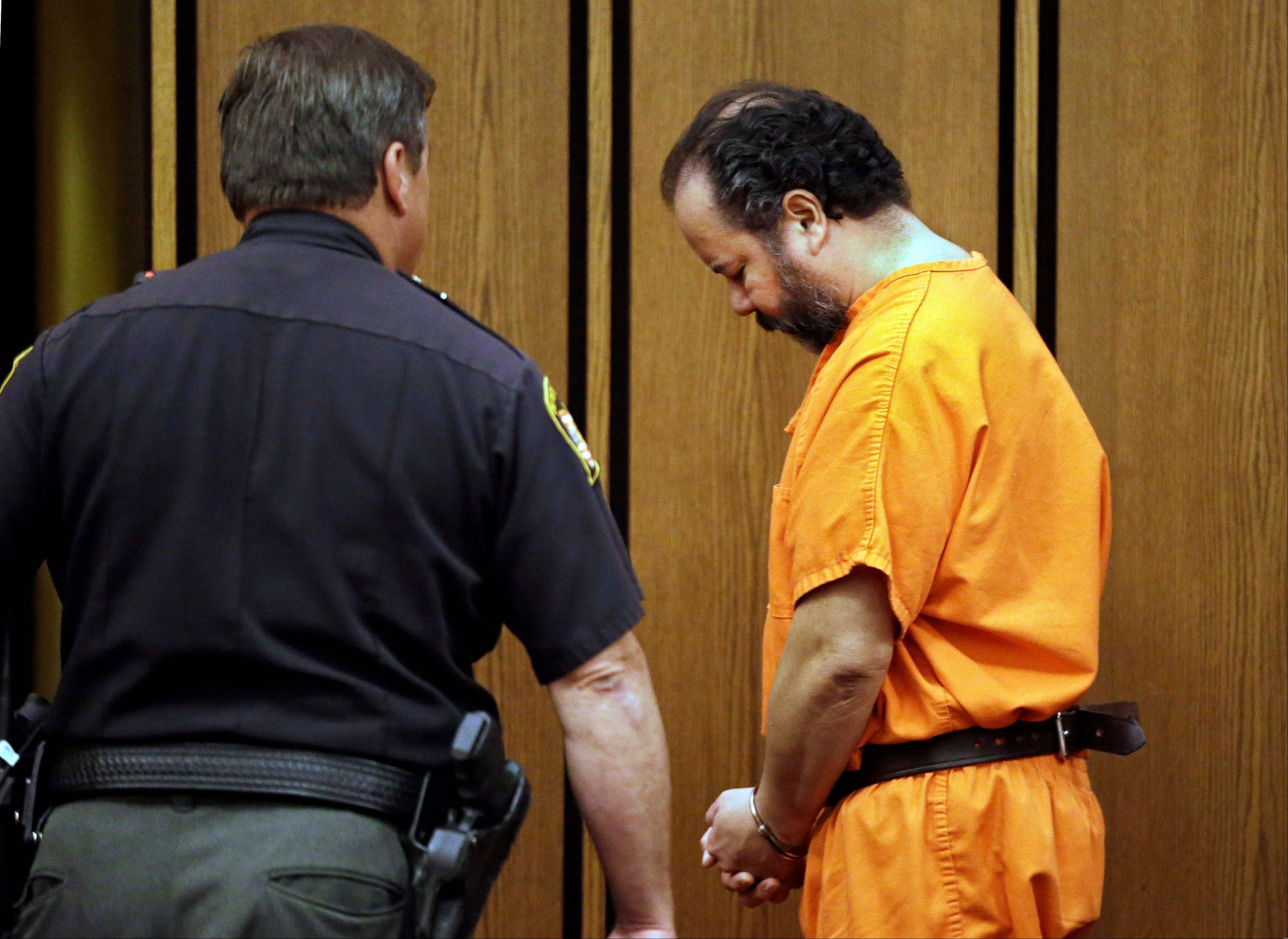 Ariel Castro is led back to jail after a hearing in Cuyahoga County Common Pleas Court in Cleveland, Wednesday, July 3, 2013. Castro is accused of holding three women captive for nearly a decade.