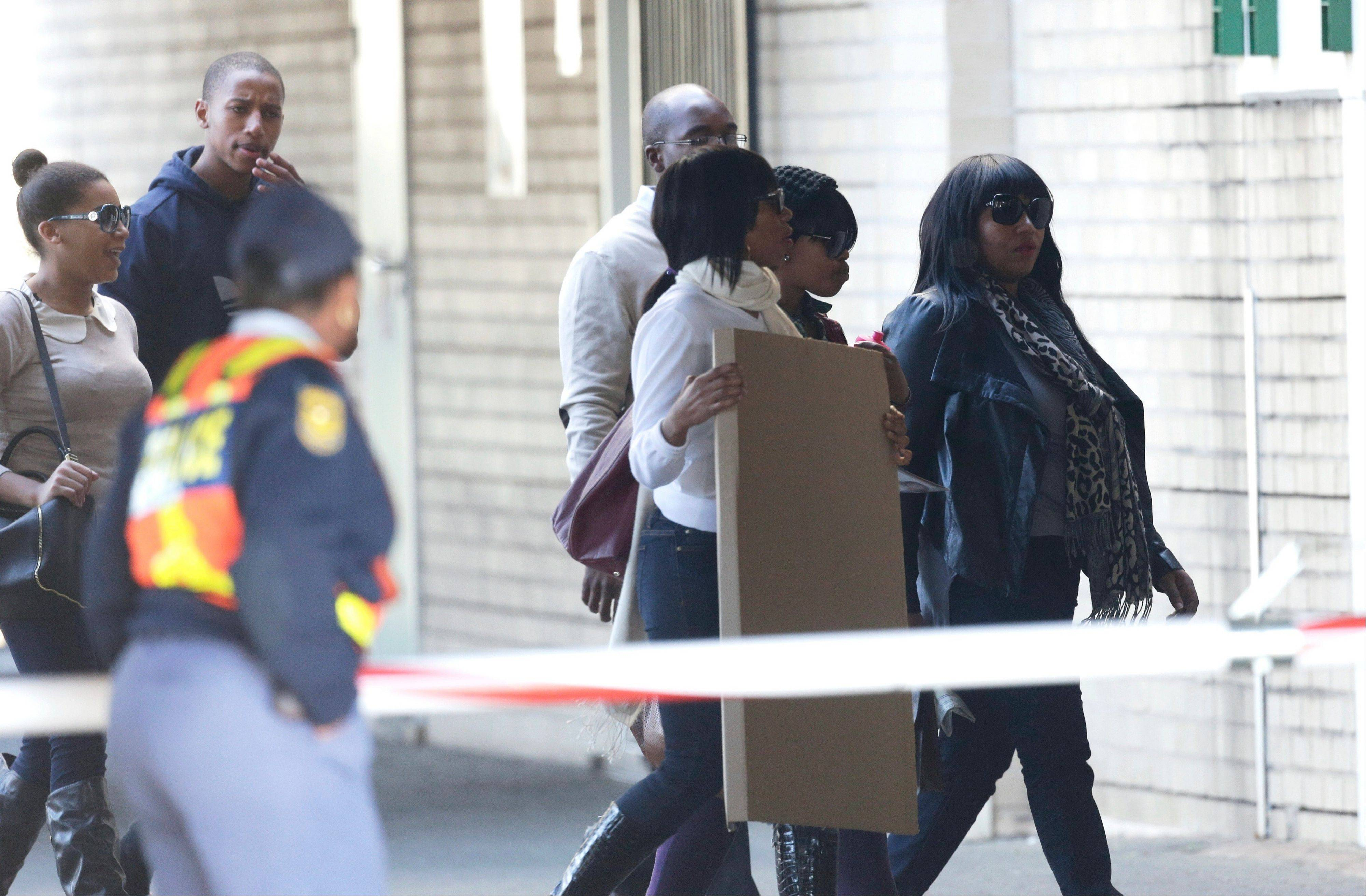Nelson Mandela's granddaughter Zaziwe Diamini Manaway, right, arrives with other relatives at the Mediclinic Heart Hospital where former South African President Nelson Mandela is being treated in Pretoria, South Africa, Wednesday, July 3, 2013. Former President Nelson Mandela remained in a critical condition on Wednesday.