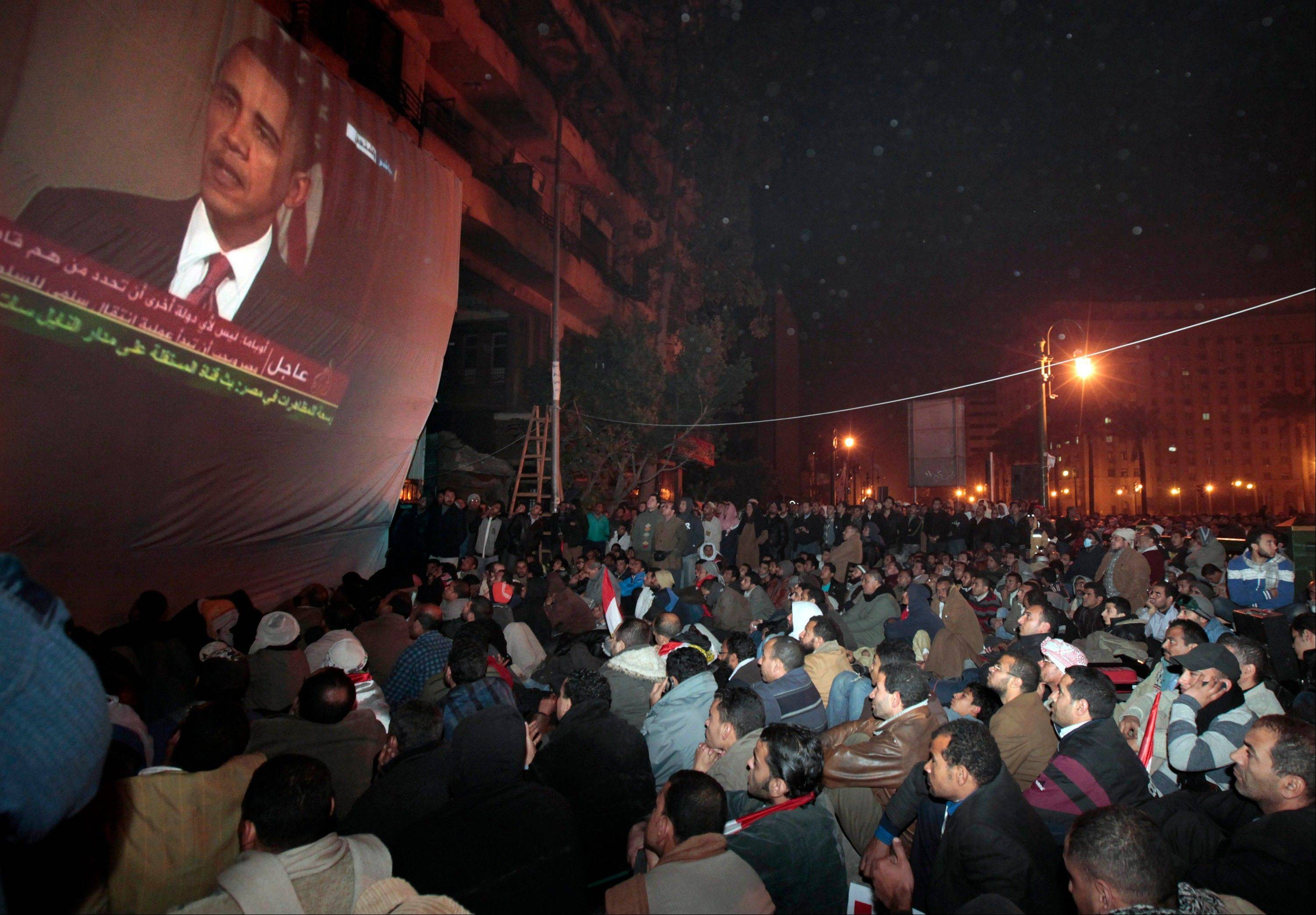 Anti-government protesters gathered in Tahrir (Liberation) Square in 2011 watch a screen showing U.S. President Barack Obama live on a TV broadcast from Washington, speaking about the situation in Egypt.