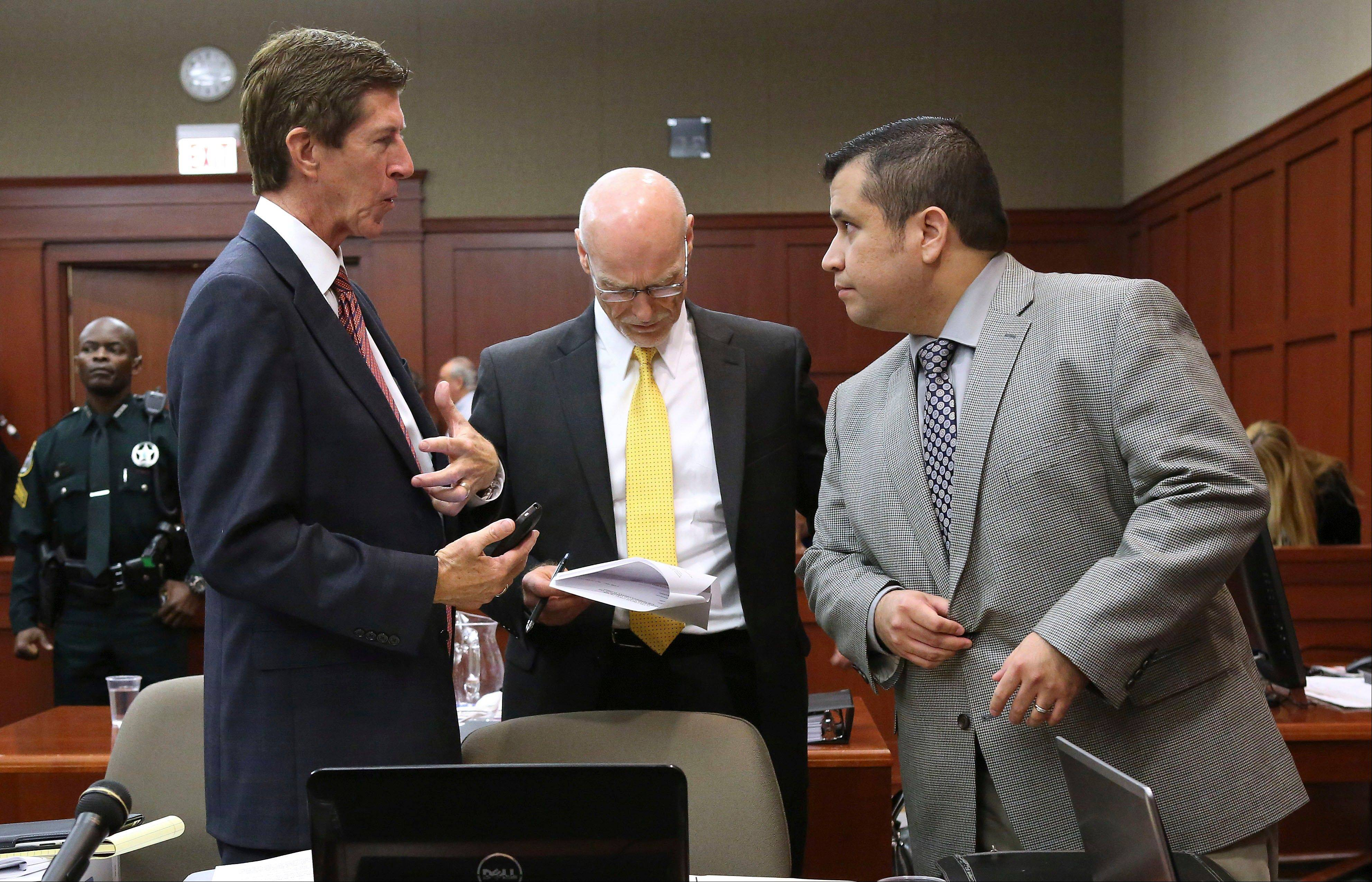 George Zimmerman, right, talks with his attorneys Mark O'Mara, left, and Don West, center, during a recess on the 17th day of Zimmerman's trial in Seminole circuit court, Tuesday, July 2, 2013 in Sanford, Fla. Zimmerman has been charged with second-degree murder for the 2012 shooting death of Trayvon Martin.