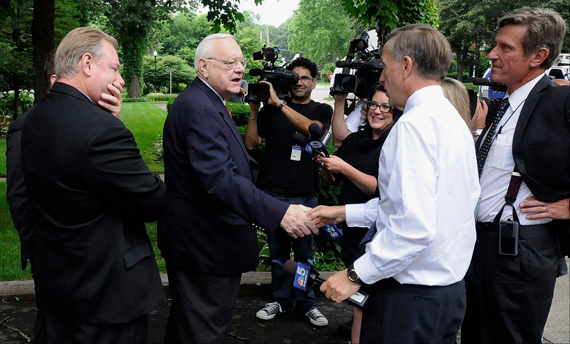 Former Gov. George Ryan speaks with reporters outside his home in Kankakee on Wednesday after he was released from home confinement.