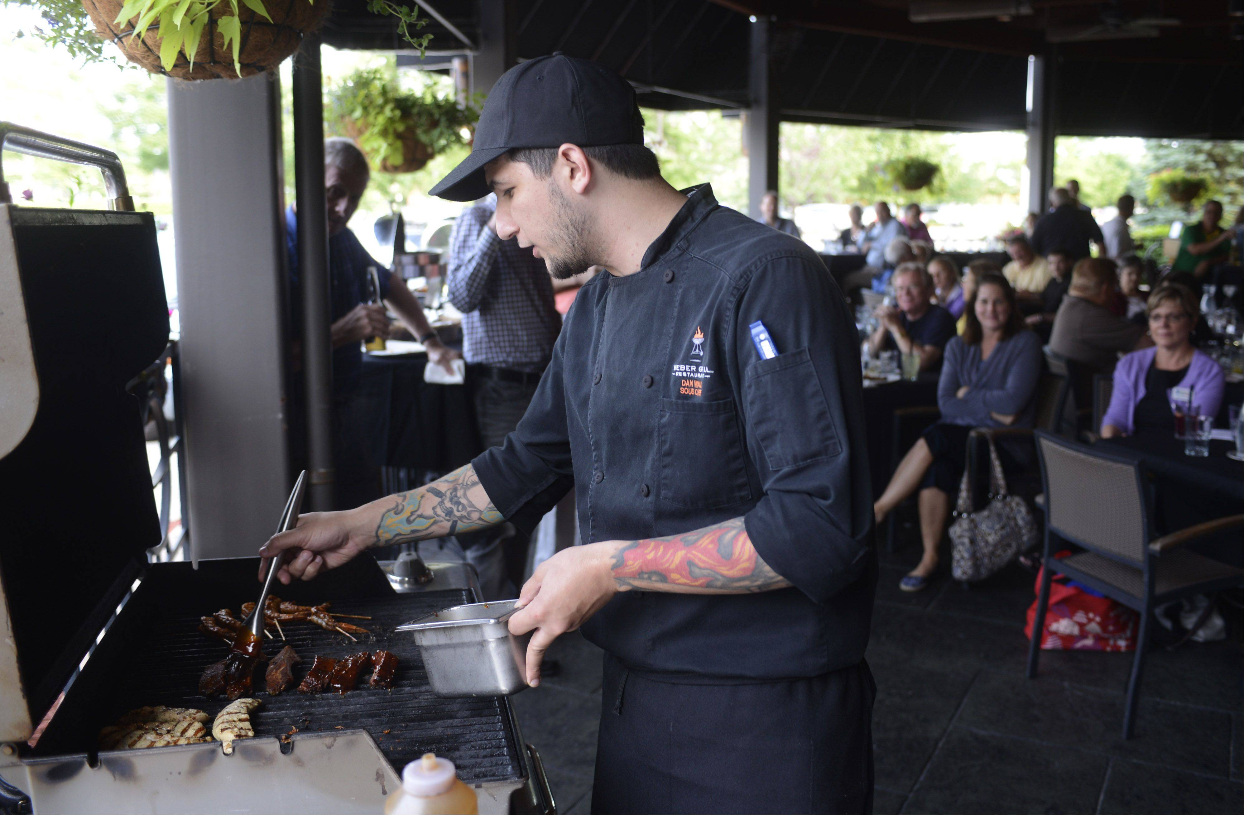 "Dan Wall, executive sous chef of the Lombard Weber Grill Restaurant, explains his grilling technique as Daily Herald subscribers are treated to ""Grilling University,"" a two-hour how-to accompanied by food and drinks at Weber Grill Restaurant in Schaumburg Tuesday."